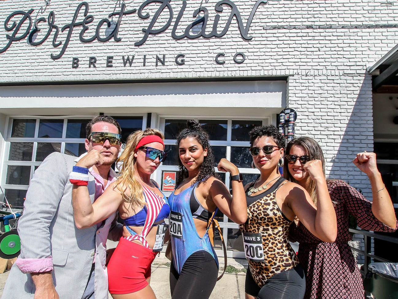 Perfect Plain Brewing Co. and Vinyl Music Hall host the inaugural Perfect Mile beer run and block party on Saturday, October 6, 2018. Teams consisted of two or four people, with each team member chugging a beer and then running one or two quarter-mile laps around Garden Street.