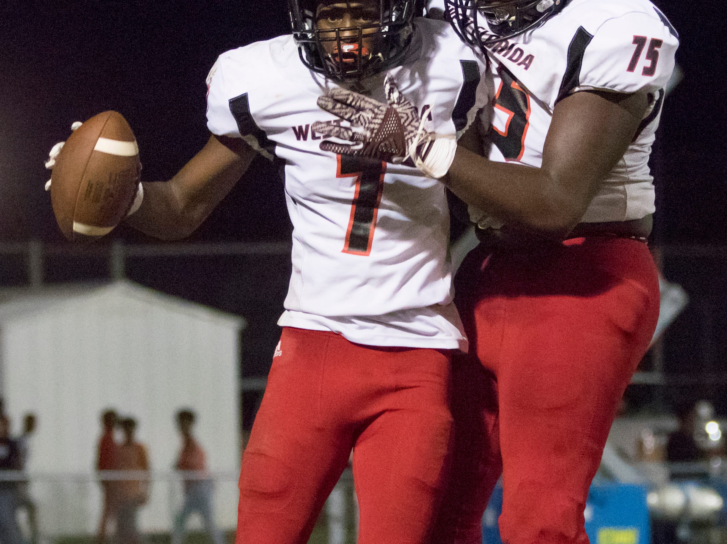 Keion Burrell (7) and Darius Washington (75) celebrate a touchdown during the West Florida vs Pine Forest football game at Pine Forest High School in Pensacola on Friday, October 5, 2018.  The Eagles lead was 14-12 after the Jaguars' 2 point attempt failed.