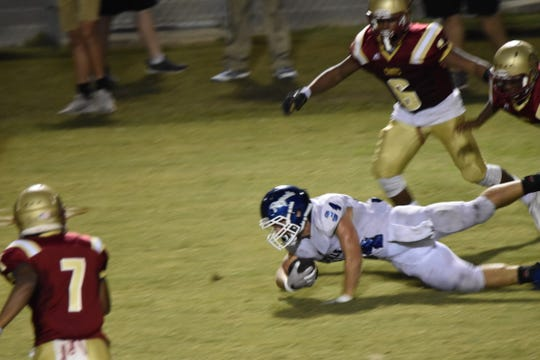 Jay High's James Eddings dives for more yards during Friday night's game at Northview's Tommy Weaver Memorial Stadium.