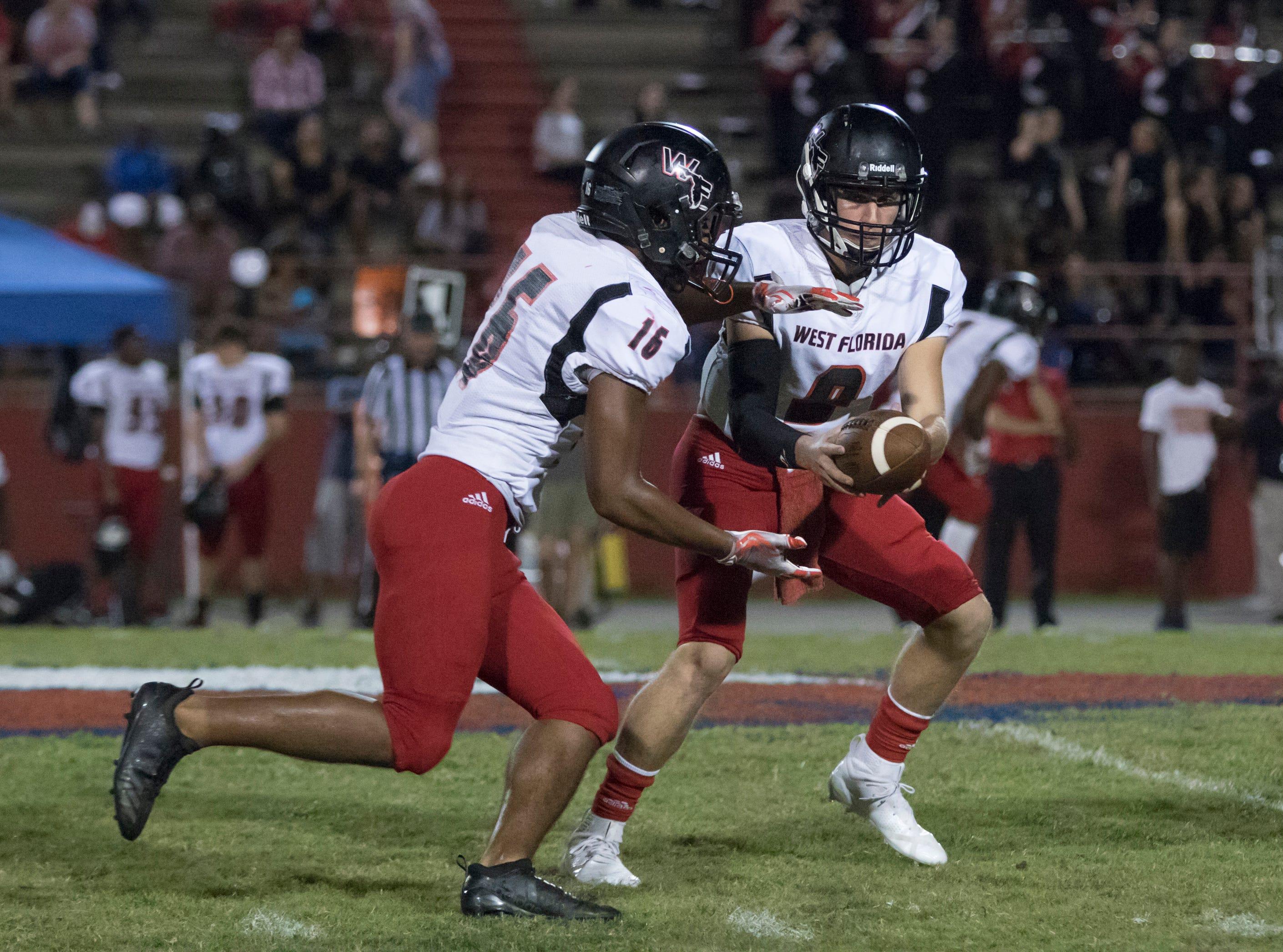 Quarterback Trevor Jordan (9) hands off to Elijah Edmonds (16) during the West Florida vs Pine Forest football game at Pine Forest High School in Pensacola on Friday, October 5, 2018.