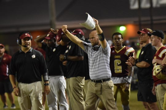 Northview coach Derek Marshman reacts to big play Friday night during Chiefs' 30-20 win against Jay at Tommy Weaver Memorial Stadium in Northview.