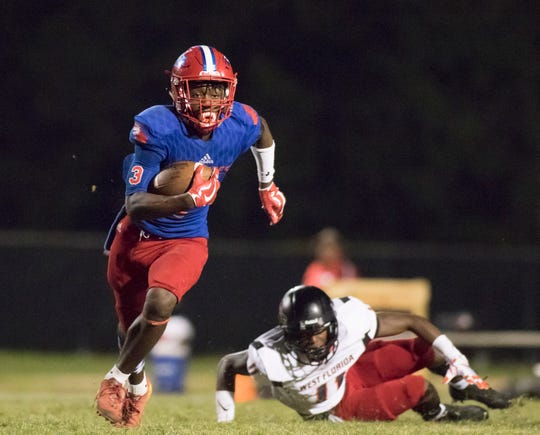 Tehrenzo Turner (7) breaks a tackle during the West Florida vs Pine Forest football game at Pine Forest High School in Pensacola on Friday, October 5, 2018.