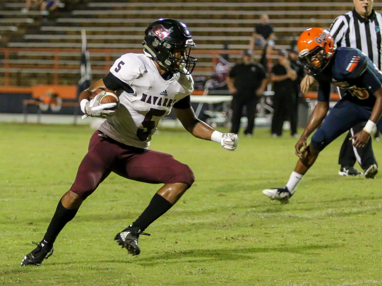 Navarre's Dante Wright (5) cuts back insie against the Gators at Escambia High School on Friday, October 5, 2018.