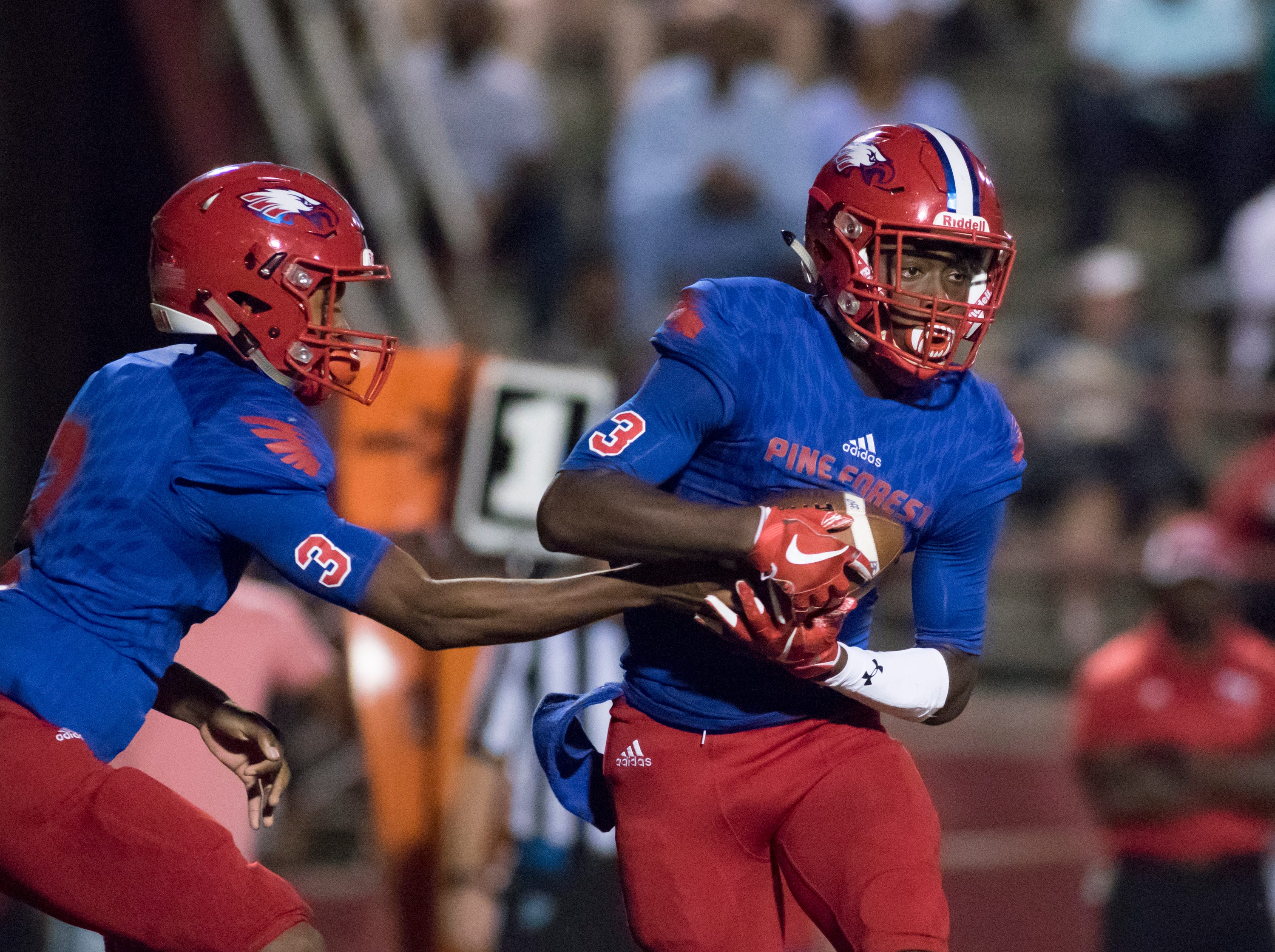Quarterback Ladarius Clardy (2) hands off to Tehrenzo Turner (7) during the West Florida vs Pine Forest football game at Pine Forest High School in Pensacola on Friday, October 5, 2018.
