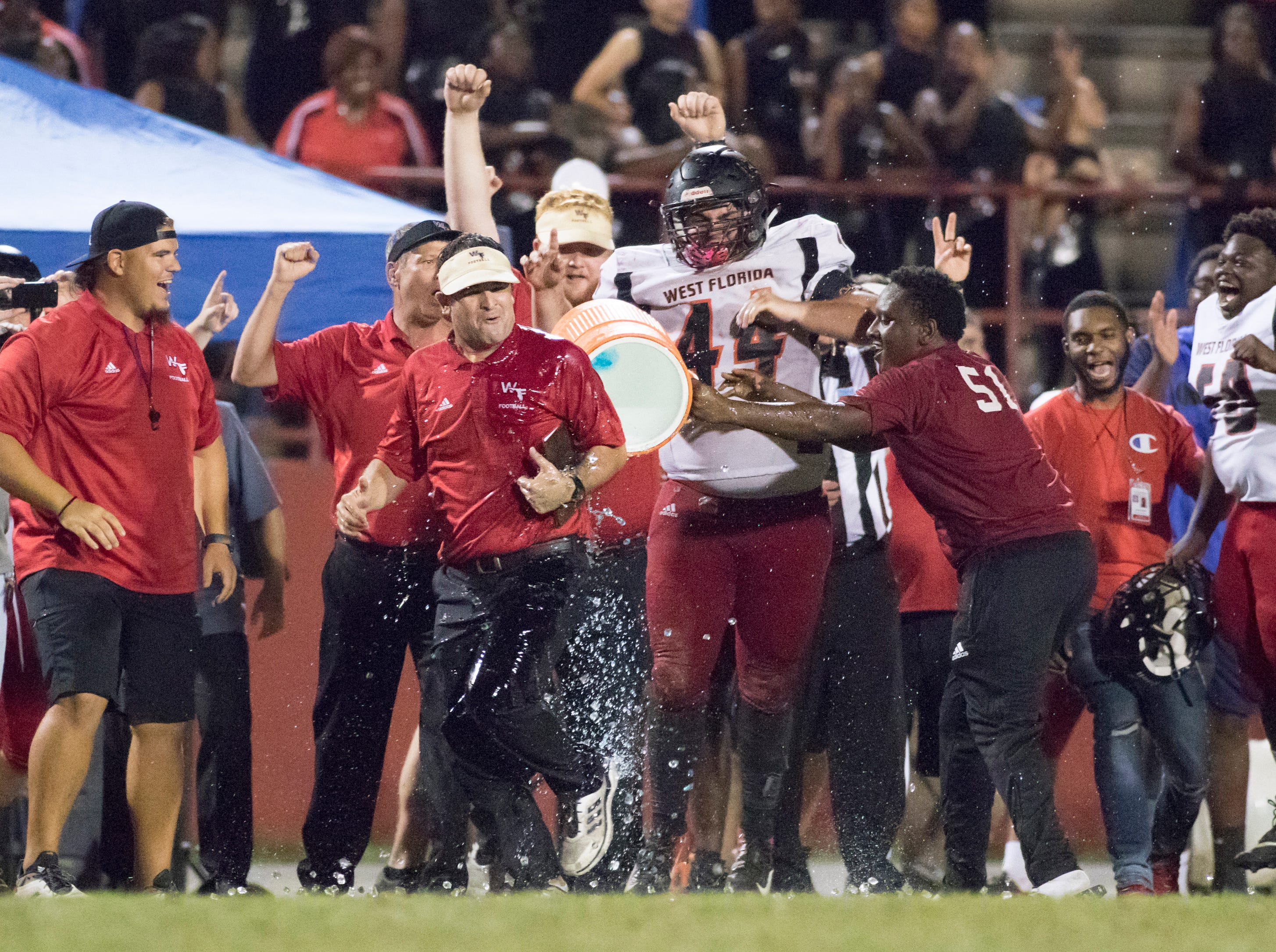 Jaguars head coach Rhett Summerford gets a Gatorade bath after a thrilling 27-24 win during the West Florida vs Pine Forest football game at Pine Forest High School in Pensacola on Friday, October 5, 2018.