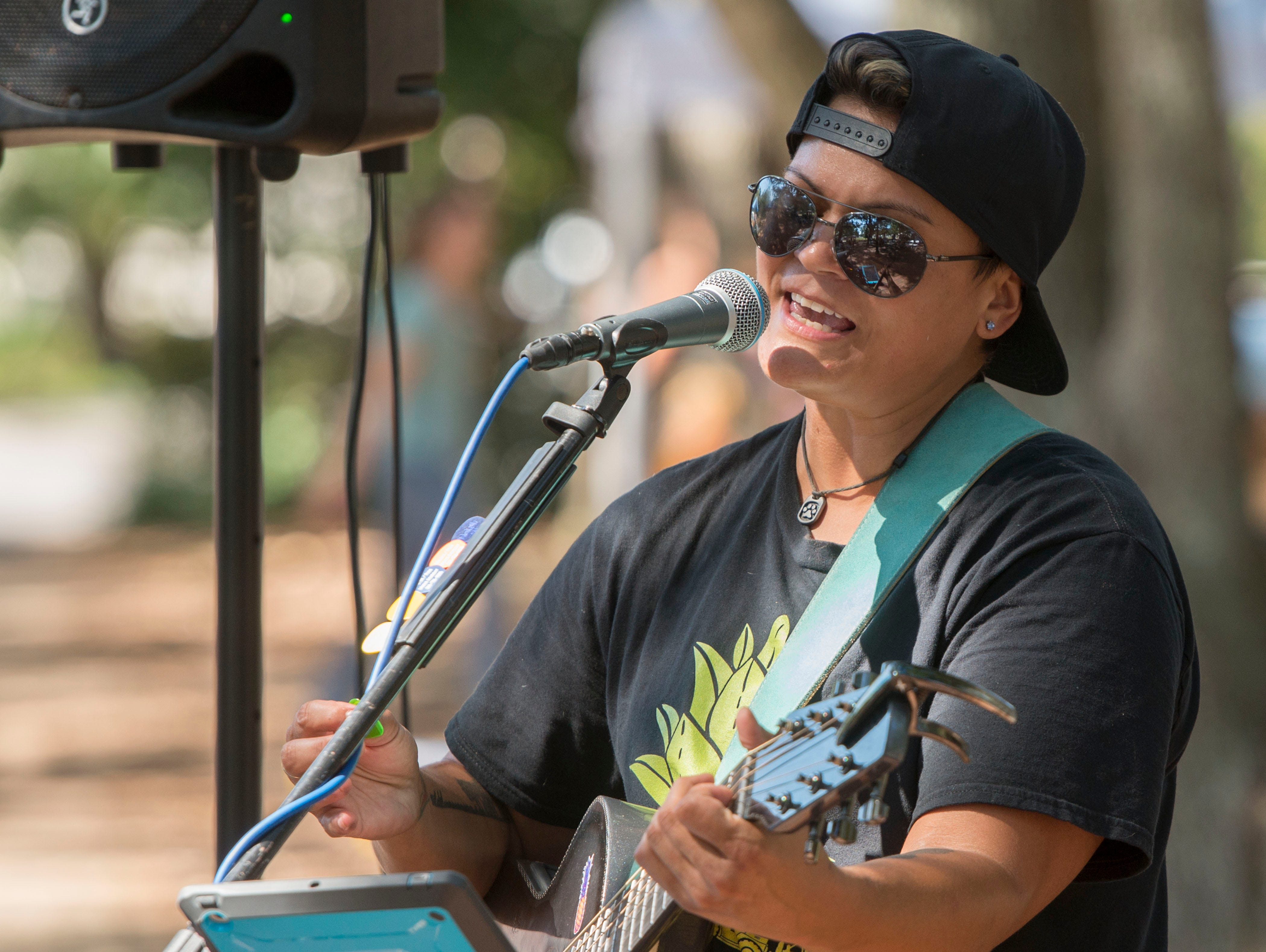 Christina Alconcel performs Saturday, October 6, 2018 during the third annual DaneTober Fest celebation and fundraising event at Seville Square. The event included music, per related merchandise,food and around two dozen aoptable Great Danes.
