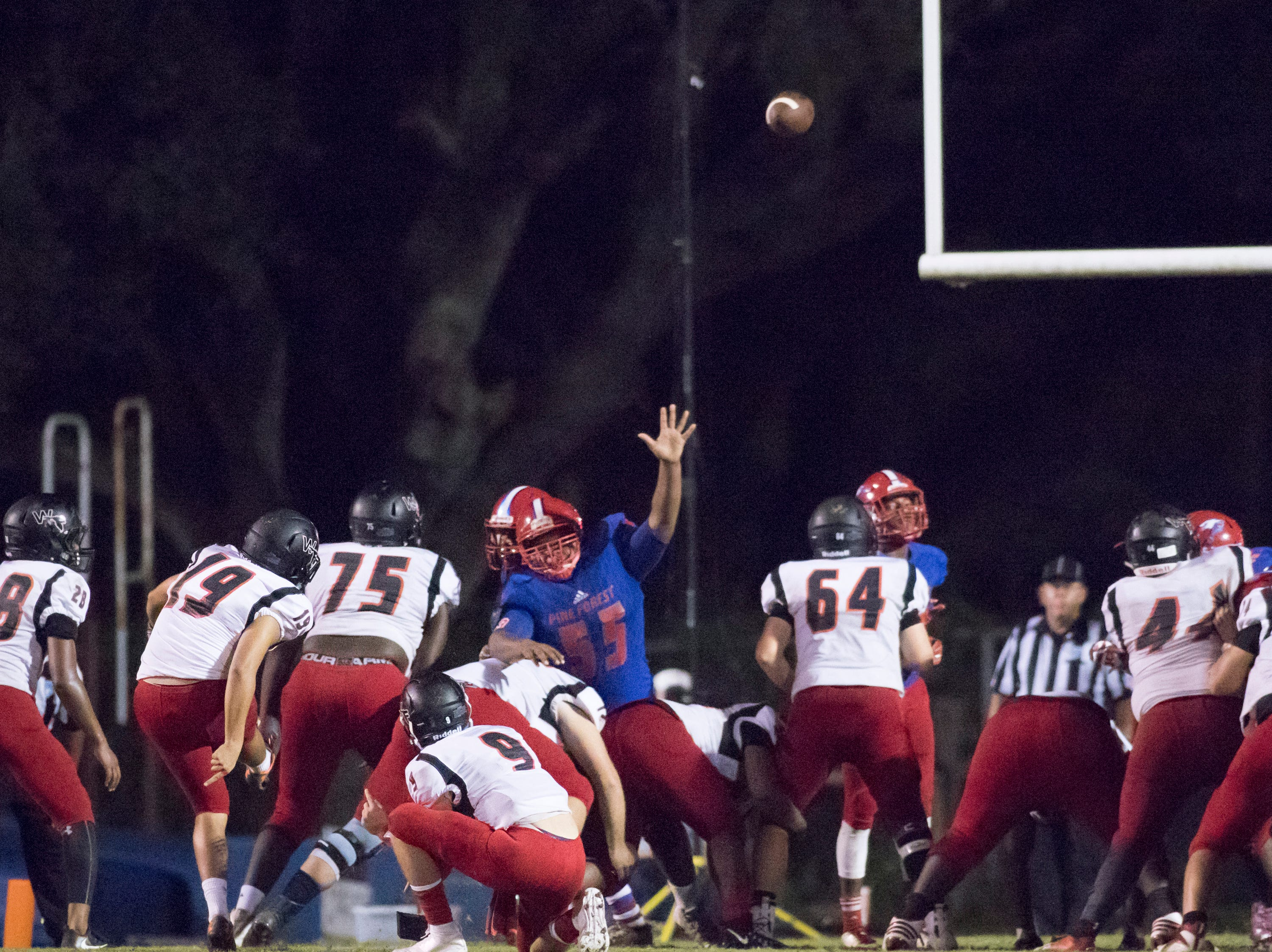 The Eagles' lead is cut to 24-19 after this Jaguars extra point during the West Florida vs Pine Forest football game at Pine Forest High School in Pensacola on Friday, October 5, 2018.