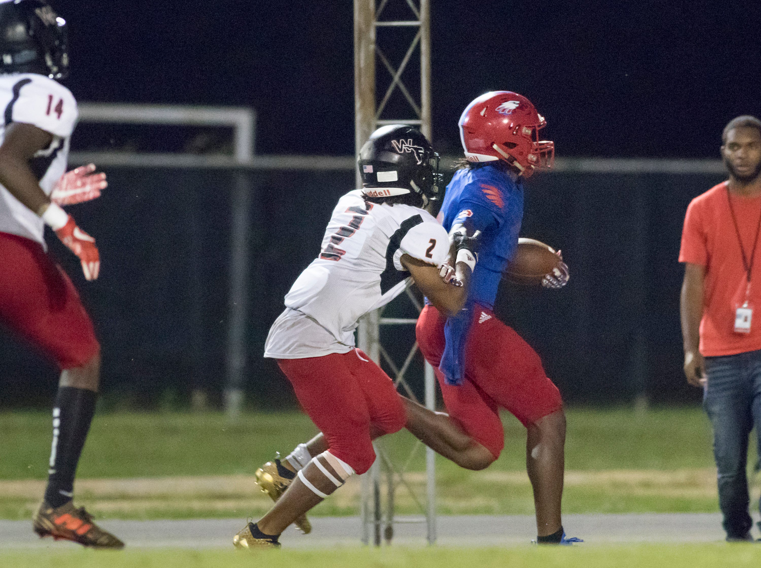 Eric Young (8) carries the ball for a big pick up during the West Florida vs Pine Forest football game at Pine Forest High School in Pensacola on Friday, October 5, 2018.