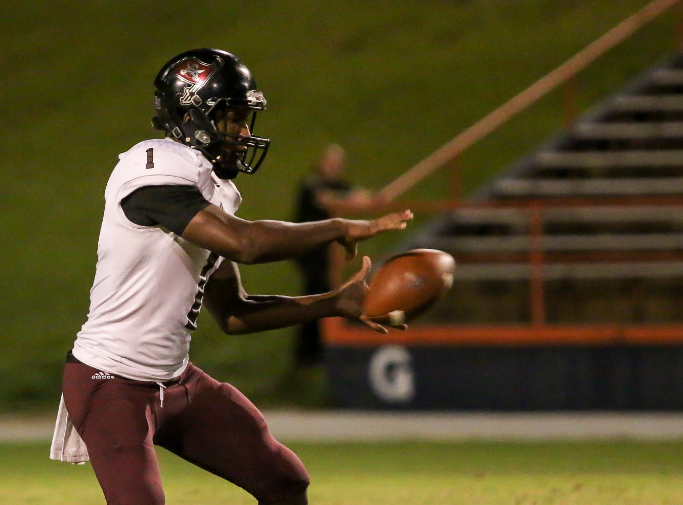 Navarre quarterback Marlon Courtney III (1) takes a snap against Escambia during the Gators' homecoming game at Escambia High School on Friday, October 5, 2018.