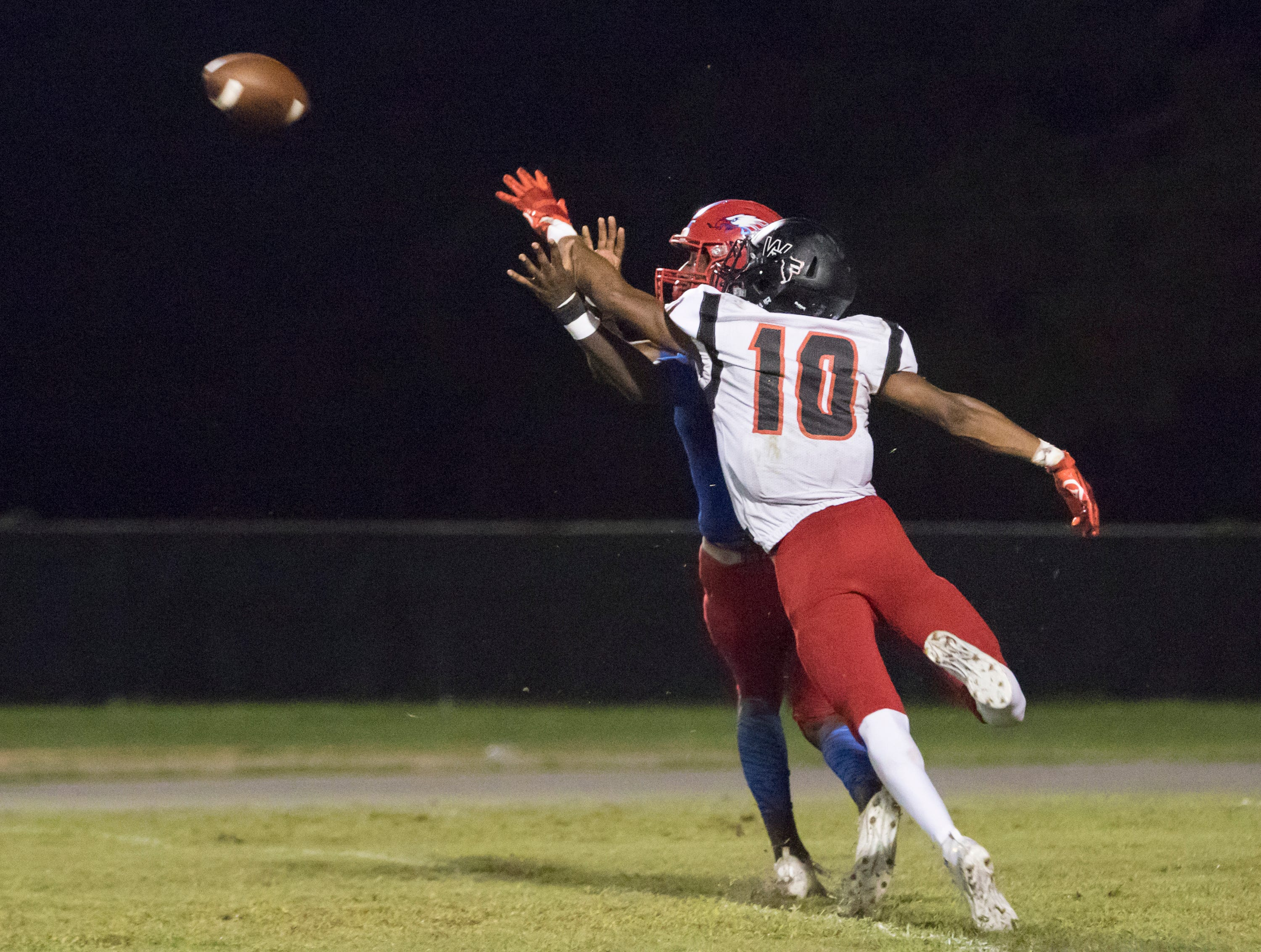 Donte Thompson (10) breaks up the pass to Vontarious Hill (4) during the West Florida vs Pine Forest football game at Pine Forest High School in Pensacola on Friday, October 5, 2018.