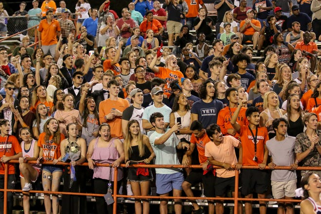 Gators' fans cheer and watch as Frank Peasant (1) races up the field for a touchdown against Navarre in the homecoming game at Escambia High School on Friday, October 5, 2018.