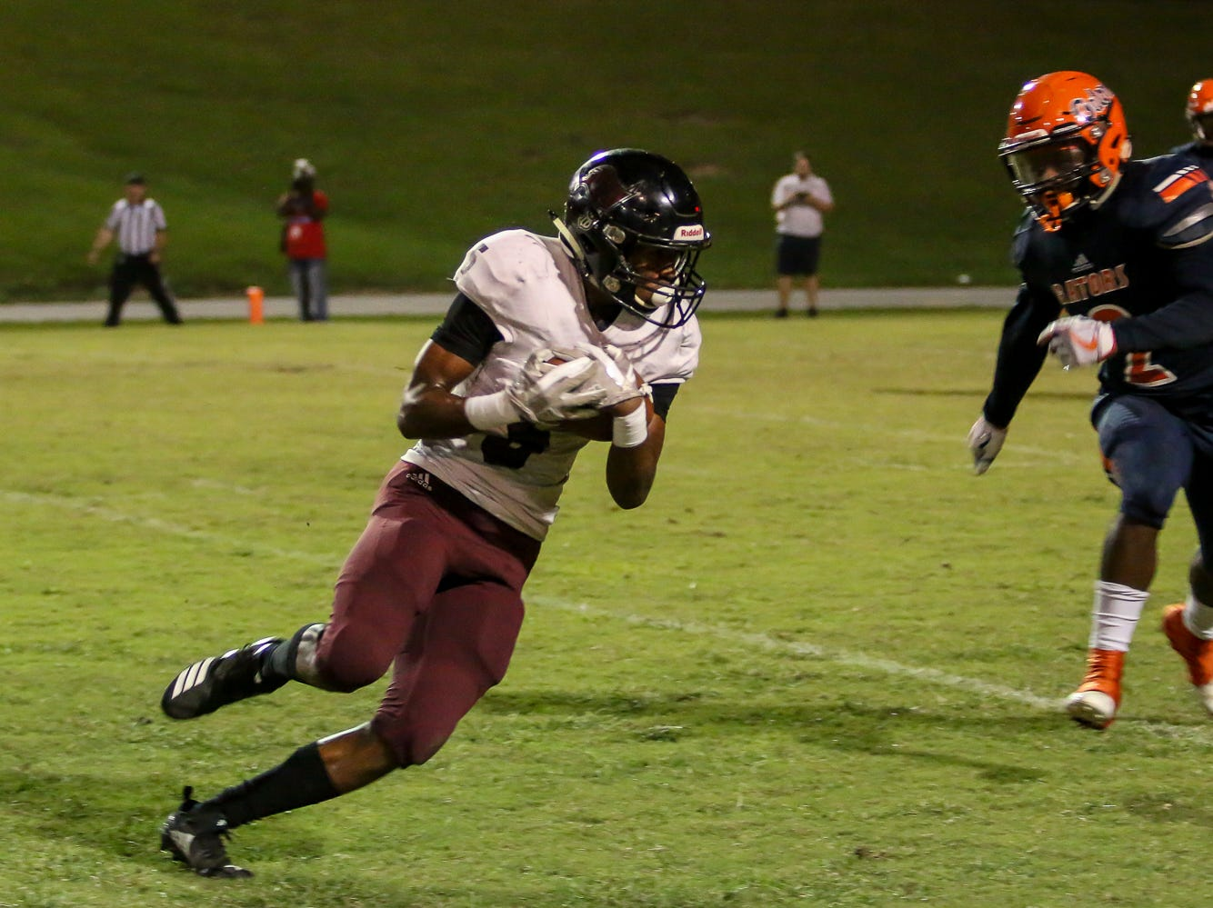 Navarre wide receiver Dante Wright (5) catches a pass from quarterback Marlon Courtney III, not pictured, and races to the outside of Escambia's Patrick Sanders (2) in the homecoming game at Escambia High School on Friday, October 5, 2018.