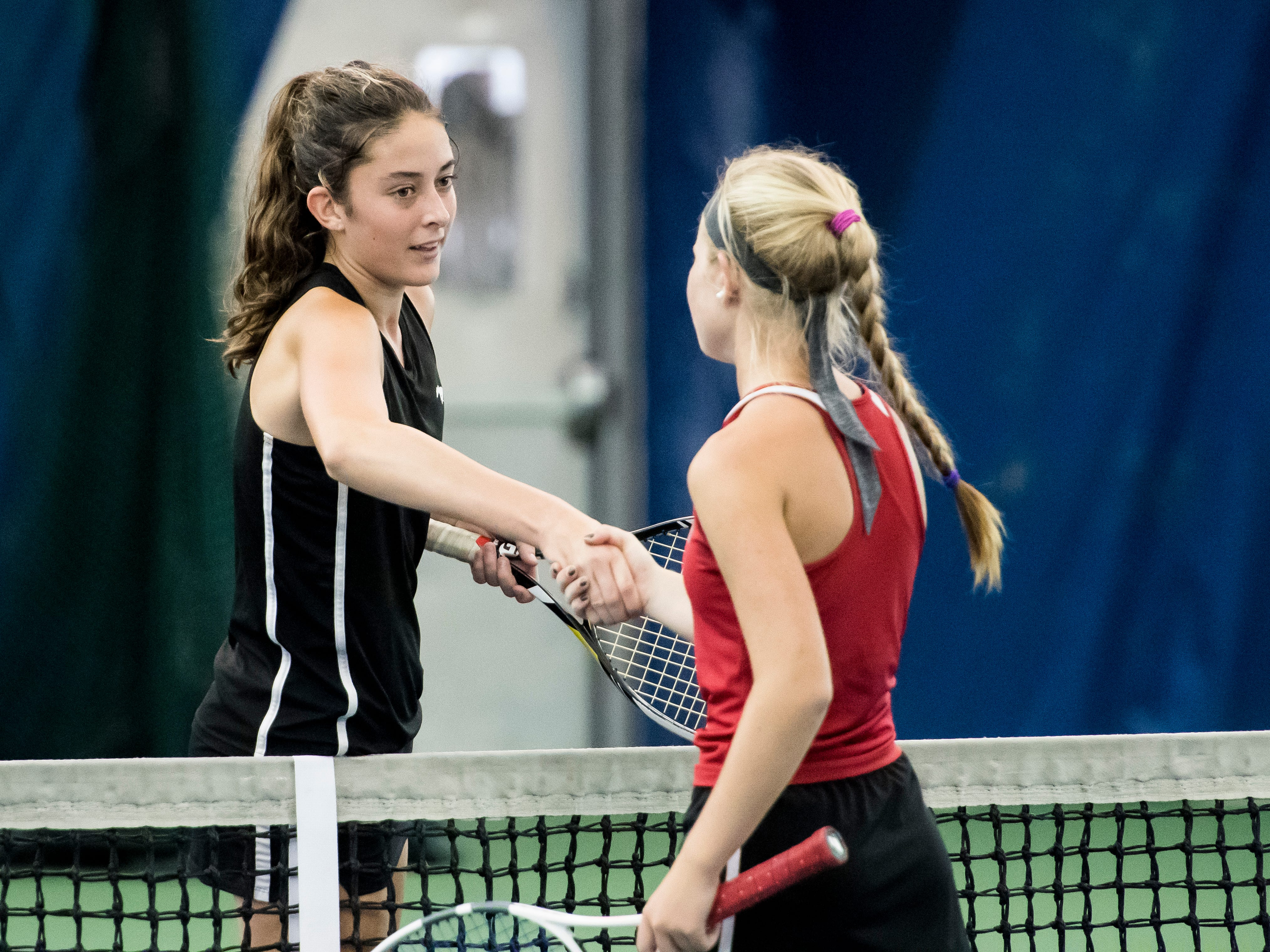 South Western's Michaela Sentz shakes hands with Susquehannock's Julianne Cassady following a semifinal match in the YAIAA 3A singles tournament at Wisehaven Tennis Center in York on October 6, 2018. Sentz won 6-1, 6-0.