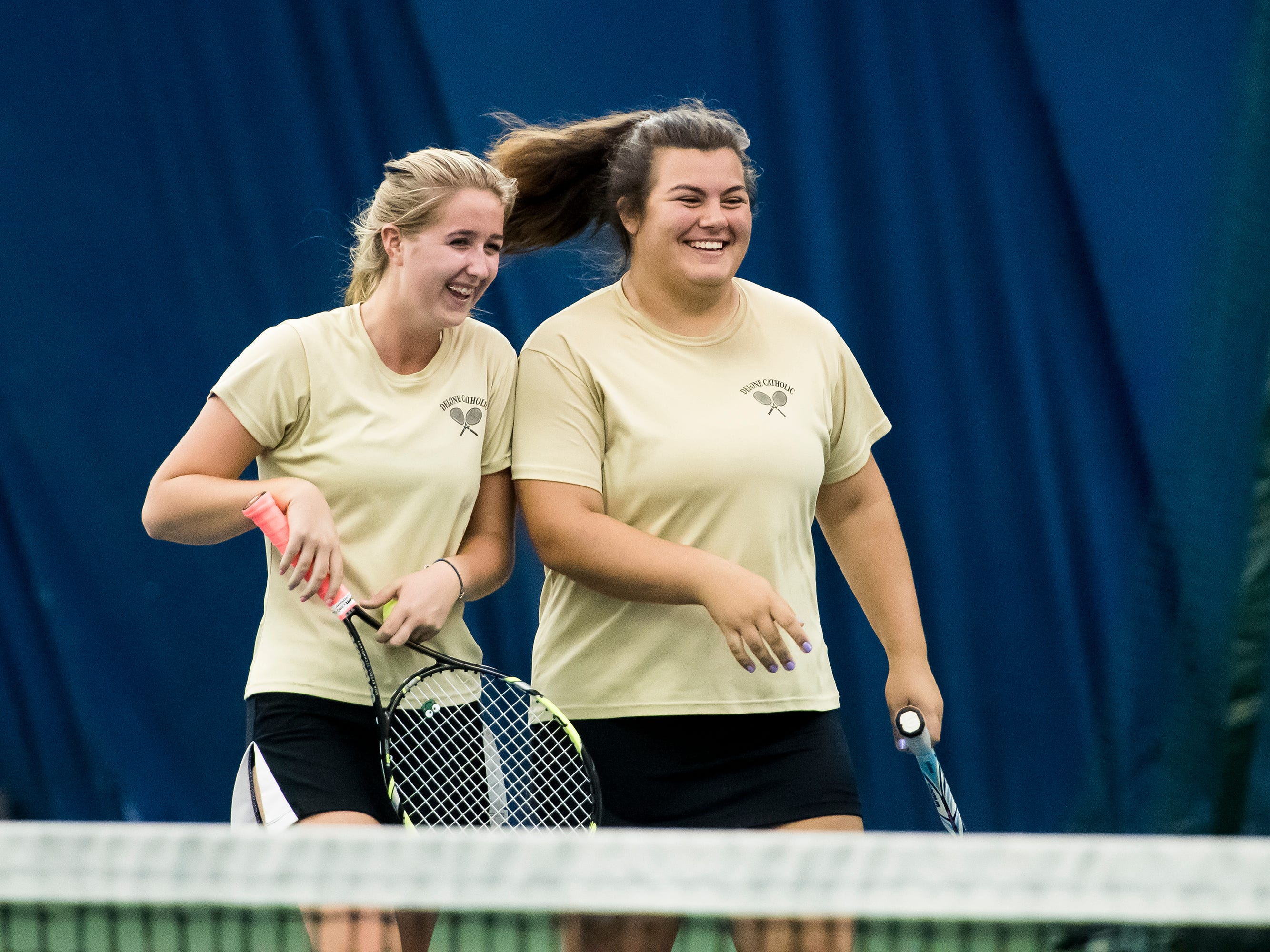 Delone Catholic tennis players Ellie Neudecker, left, and Becca Dolce laugh together after facing off in the YAIAA 2A singles championship match at Wisehaven Tennis Center in York on October 6, 2018. Neudecker won 6-0, 6-1.