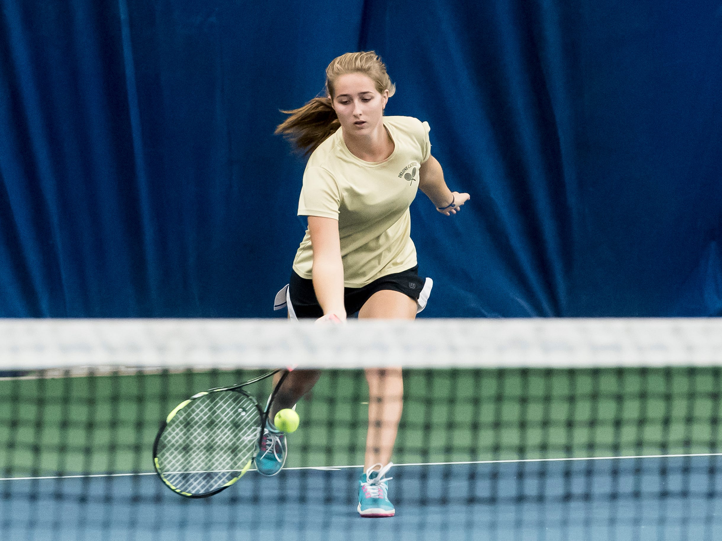 Delone Catholic's Ellie Neudecker scoops a low ball during the championship match in the YAIAA 2A singles tournament at Wisehaven Tennis Center in York on October 6, 2018. Neudecker defeated Delone Catholic teammate Becca Dolce 6-0, 6-1.