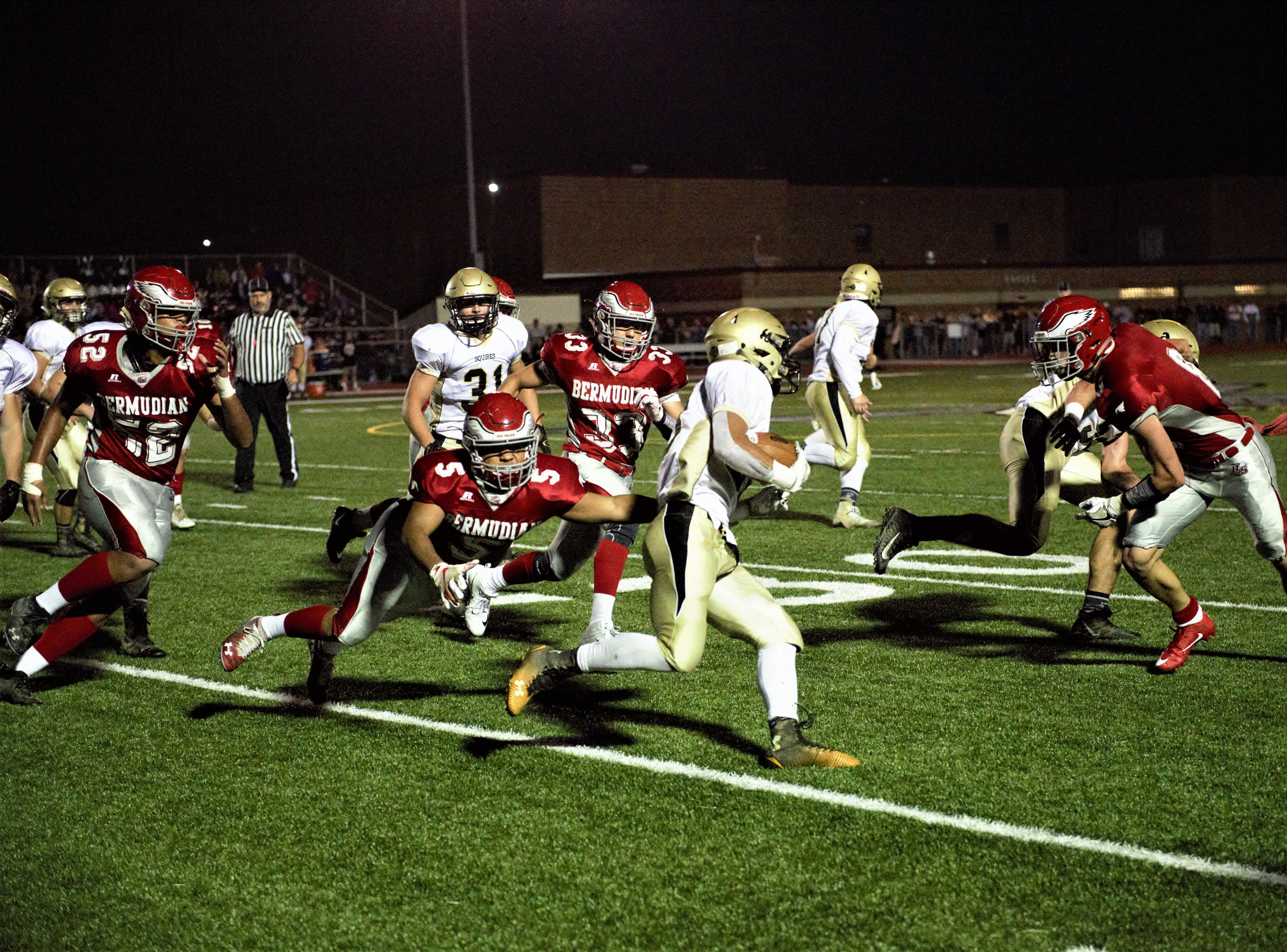 Delone Catholic player running the ball down the field at Bermudian Springs on Oct. 5.