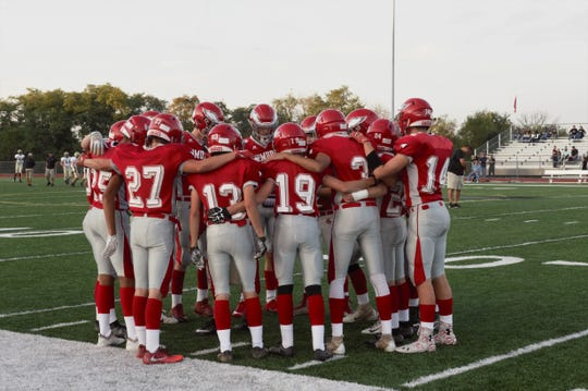 Bermudian Springs Eagles huddle up before their home game against the Delone Catholic Squires on Oct. 5.