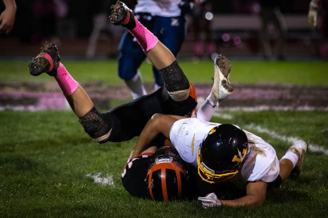 Hanover's Josh Postell (13) is brought down by Littlestown's Zackary Lanning (11) during a football game between Hanover and Littlestown, Friday, Oct. 5, 2018, at the Sheppard-Meyers field in Hanover.