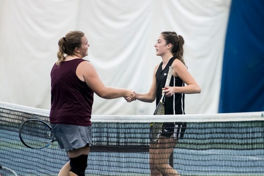 South Western's Michaela Sentz, right, and New Oxford's Kamdyn Balko shake hands following the championship match in the YAIAA 3A singles tournament at Wisehaven Tennis Center in York on October 6, 2018. Sentz won 6-7 (7-9), 6-0, 6-3.