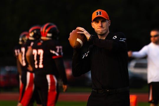 In this file photo, Hanover head coach Brandon Bishop helps his team warm up before a football game between Hanover and Littlestown, Friday, Oct. 5, 2018, at the Sheppard-Meyers field in Hanover.