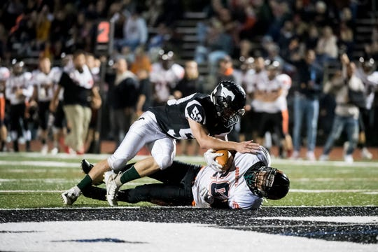 Northeastern's Manny Capo is tackled just short of the goal line during play against South Western on Friday, October 5, 2018. The Bobcats won 38-16.