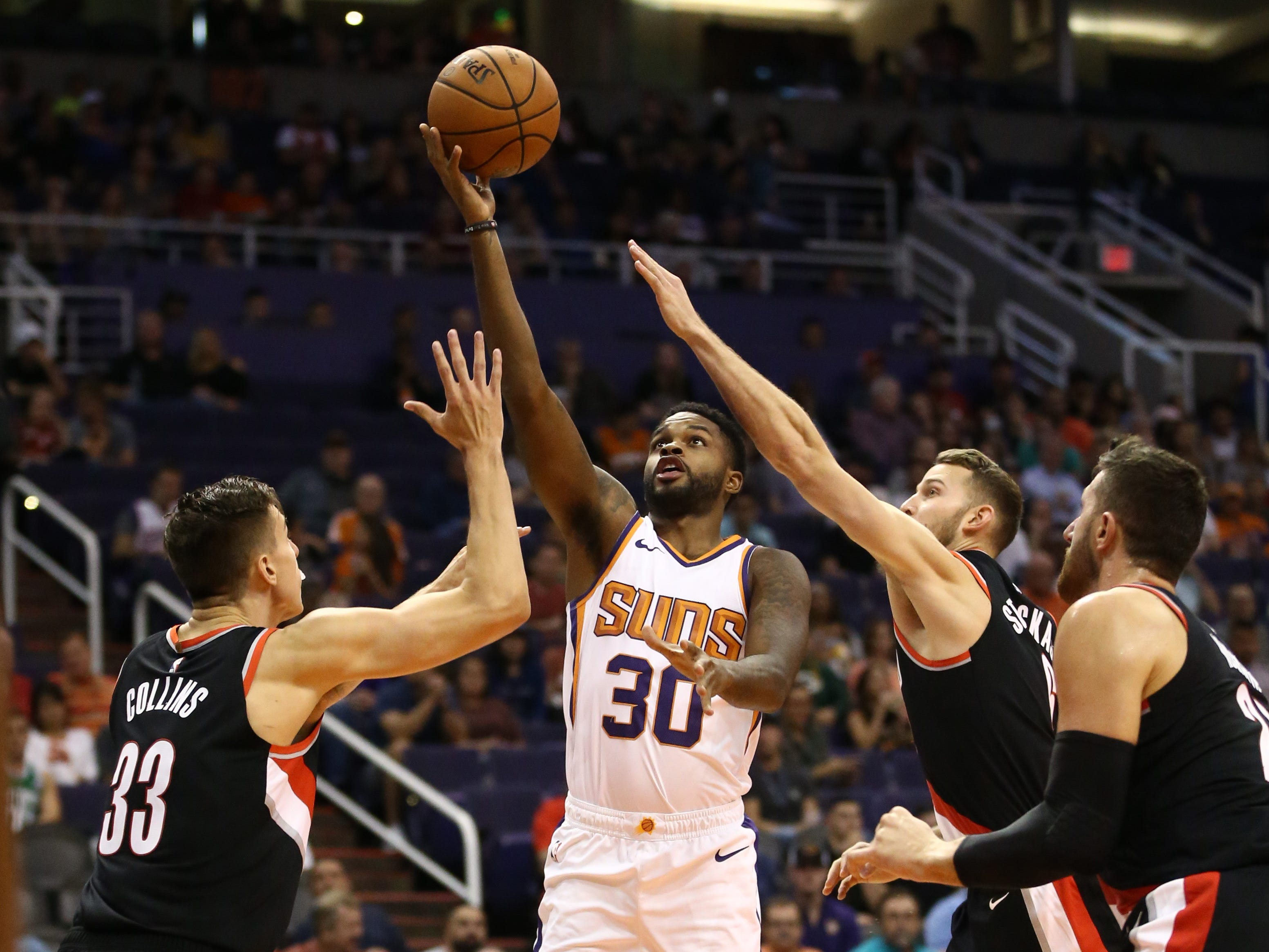 Phoenix Suns Troy Daniels drives to the basket against the Portland Trail Blazers during a preseason game at Talking Stick Resort Arena on Oct. 5, 2018, in Phoenix, Ariz.