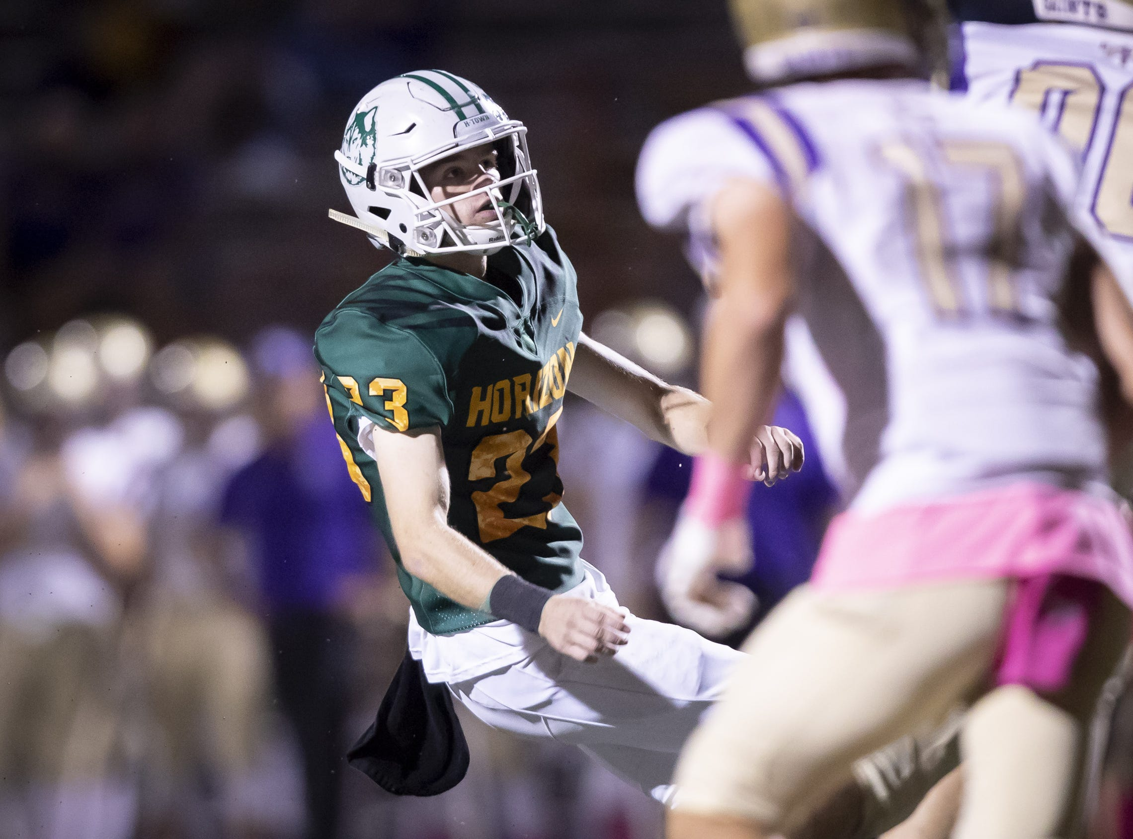 Senior kicker Cole Johnson (23) of the Horizon Huskies kicks an extra point during the game against the Notre Dame Prep Saints at Horizon High School on Friday, October 5, 2018 in Scottsdale, Arizona. #azhsfb