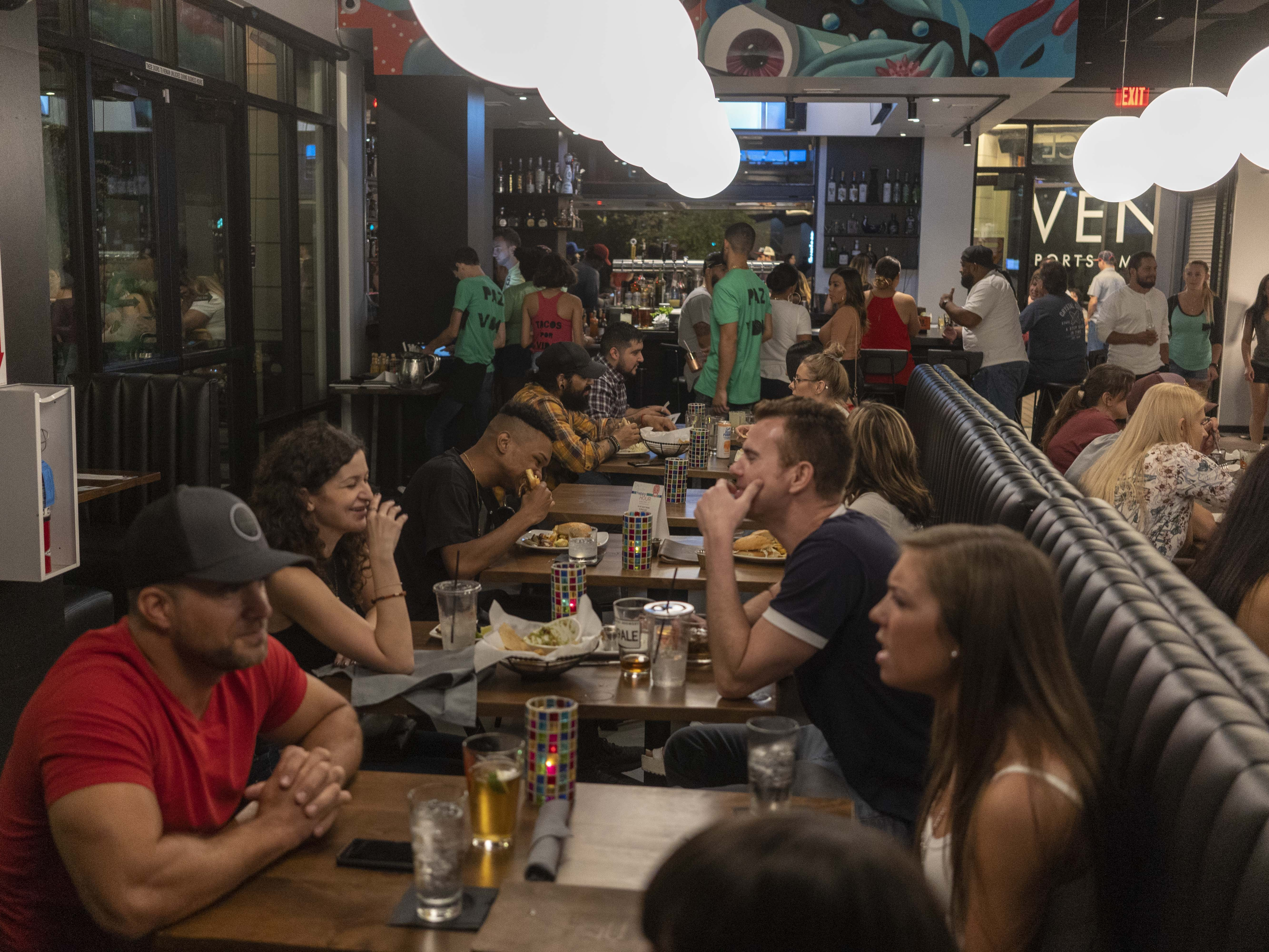 People enjoy food at PAZ during the First Friday Art walk, Roosevelt Street in Downtown Phoenix, on Oct. 5, 2018.