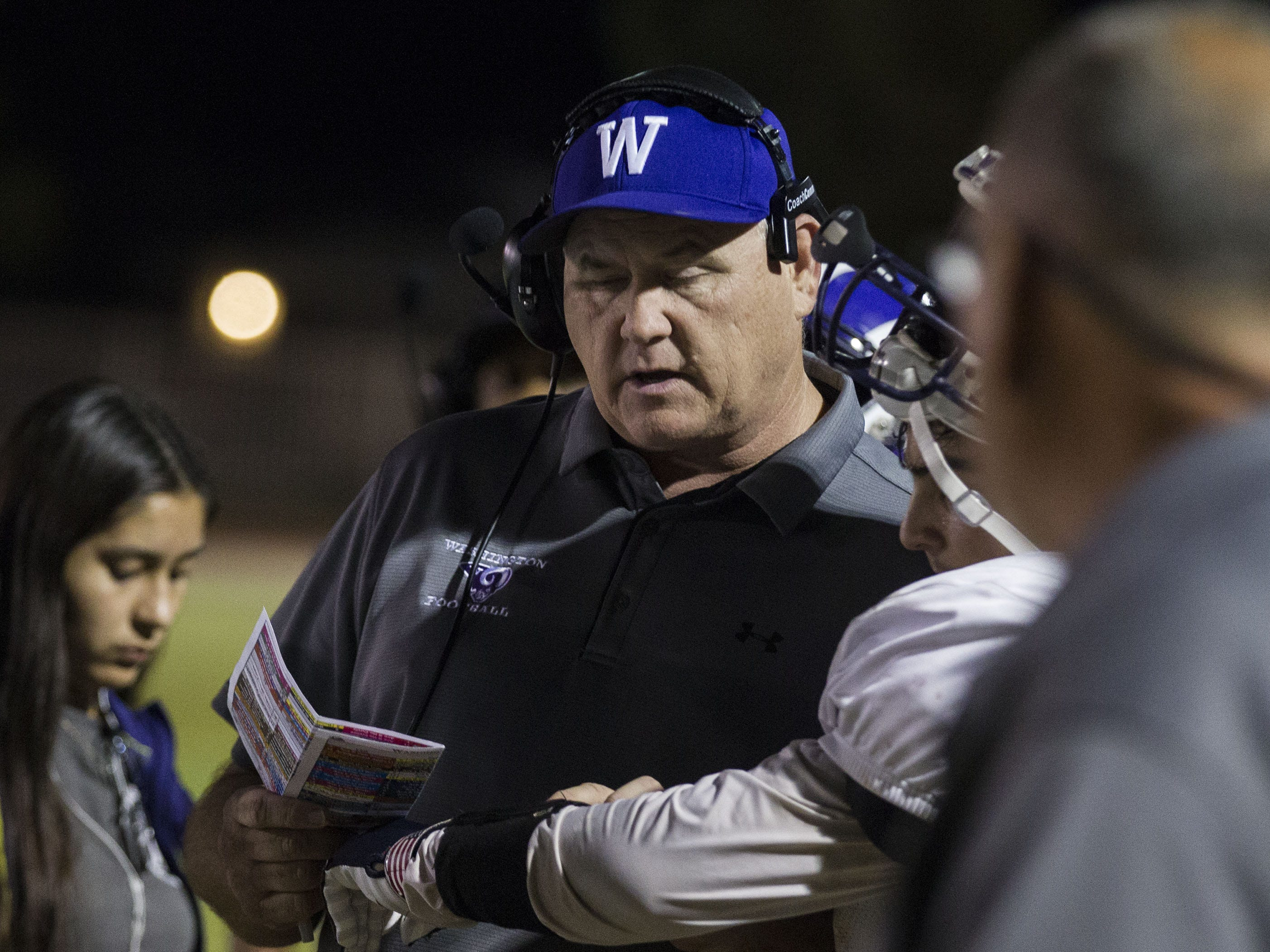 Washington coach Tim MayfieldÊtalks to his players during their game with Glendale in Glendale Friday, Oct. 5, 2018. #azhsfb