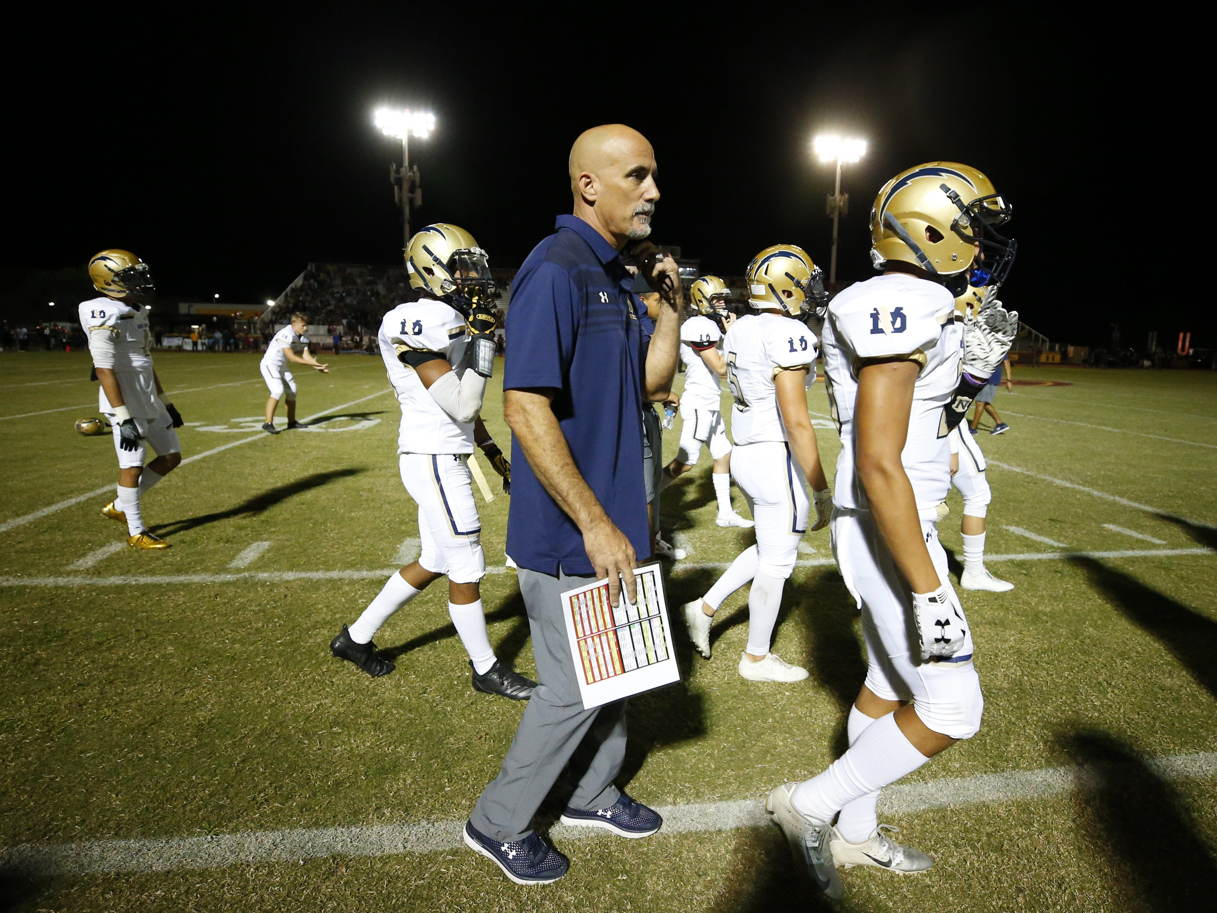 Desert Vista head coach Dan Hinds walks on the sidelines after talking to his players during a high school football game against the Mountain Pointe at Mountain Pointe in Phoenix on October 5, 2018. #azhsfb