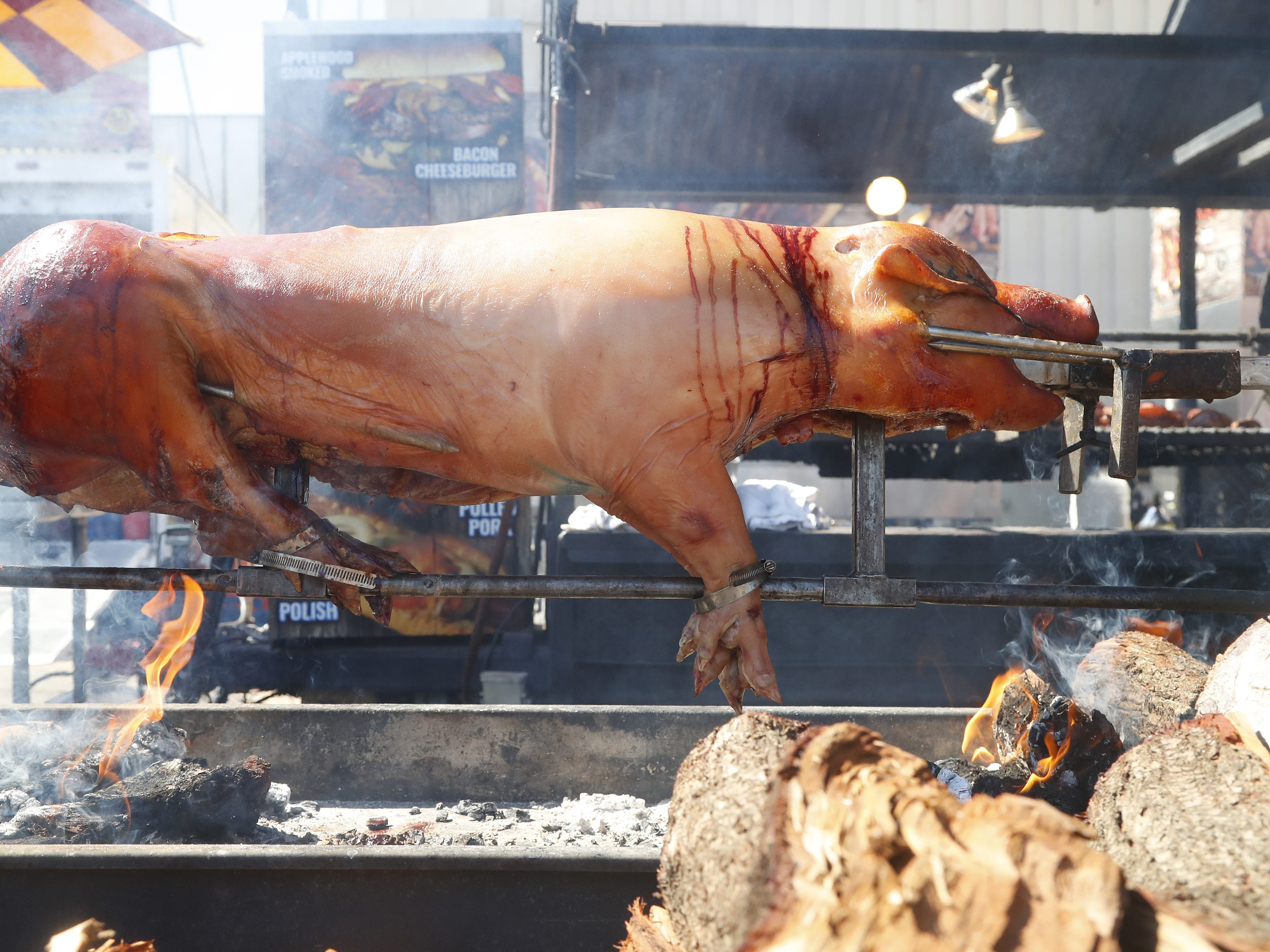 A pig is barbecued at the Arizona State Fair in Tempe, Ariz. on October 5, 2018.