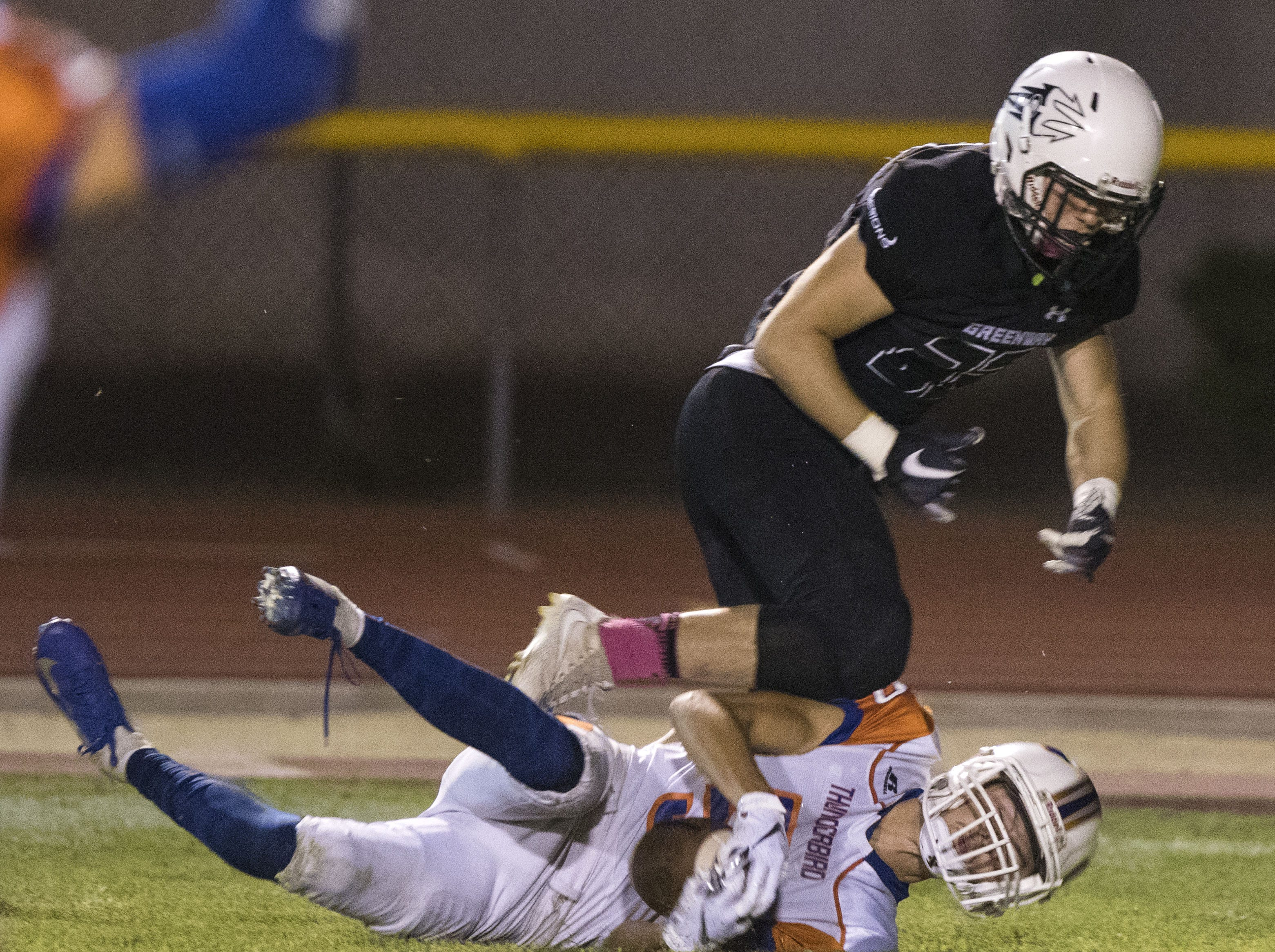 Despite being on the bottom Thunderbird's Joey Hamen comes up with an interception during their game with Washington in Phoenix Friday, Oct. 5, 2018. #azhsfb