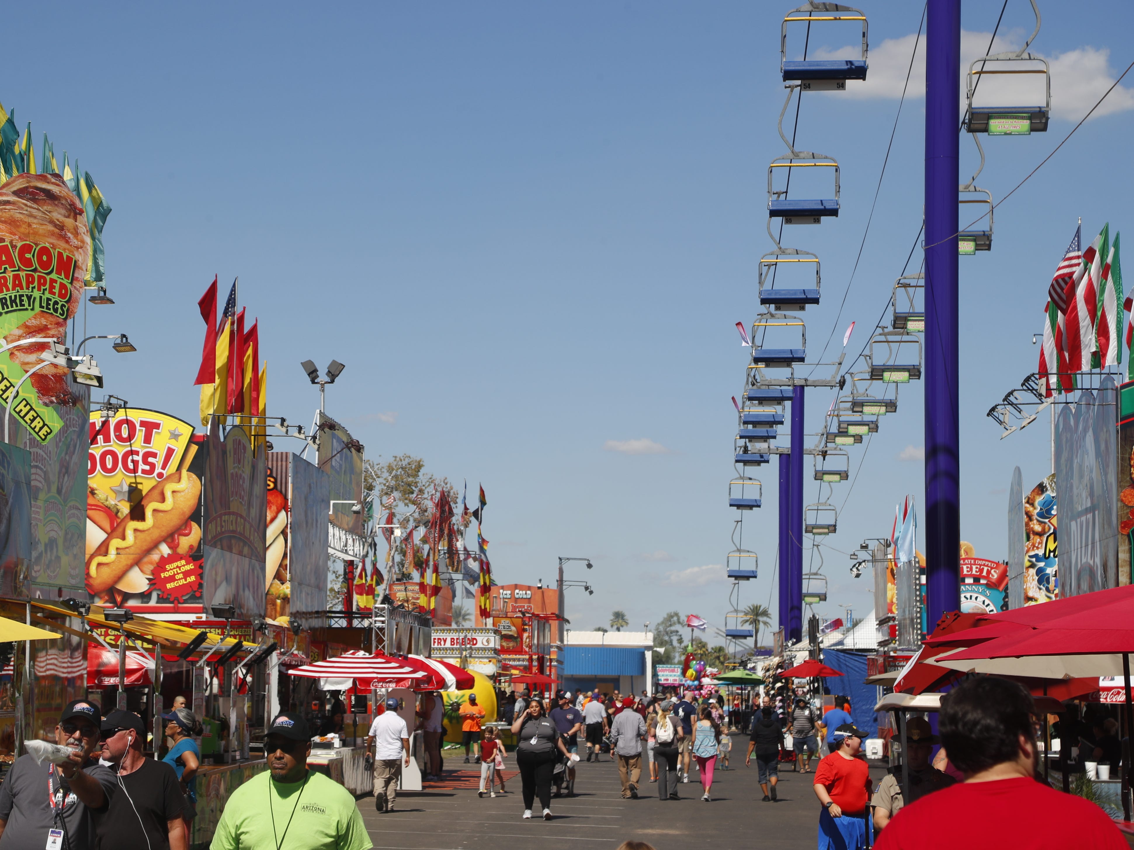 People arrive at the opening at the Arizona State Fair in Tempe, Ariz. on October 5, 2018.