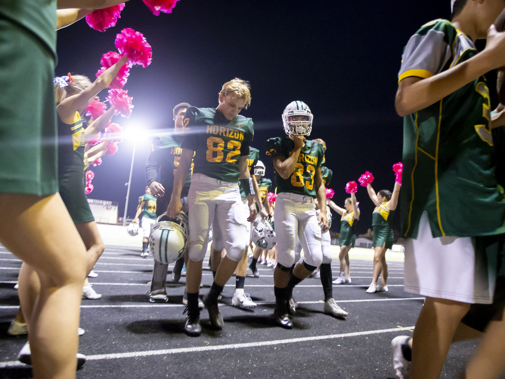 The Horizon Huskies walk off the field following their loss against the Notre Dame Prep Saints at Horizon High School on Friday, October 5, 2018 in Scottsdale, Arizona. #azhsfb