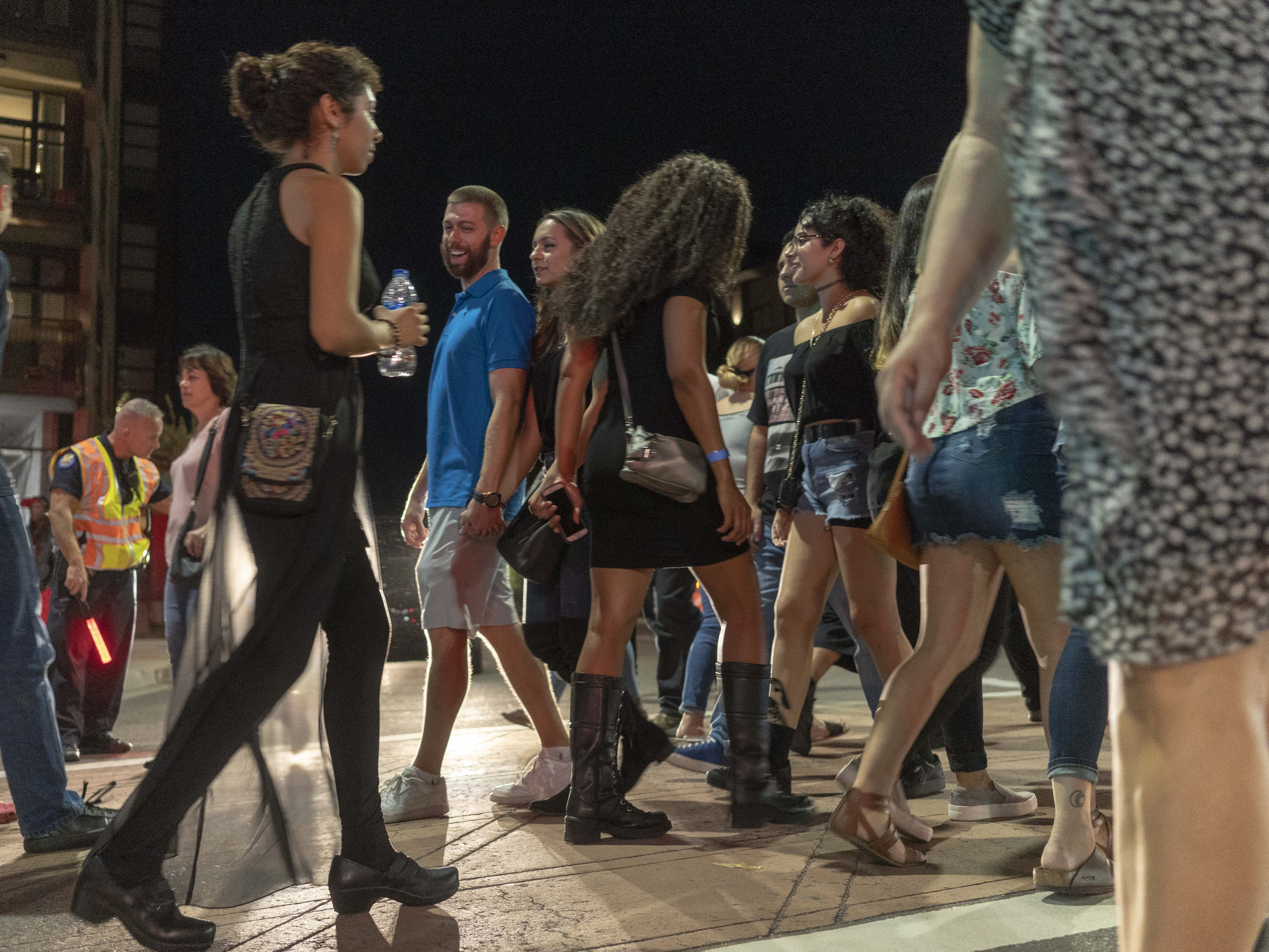 People enjoy street dance and art work  during the First Friday Art walk, on Roosevelt Street in Downtown Phoenix, on Oct 5th, 2018.