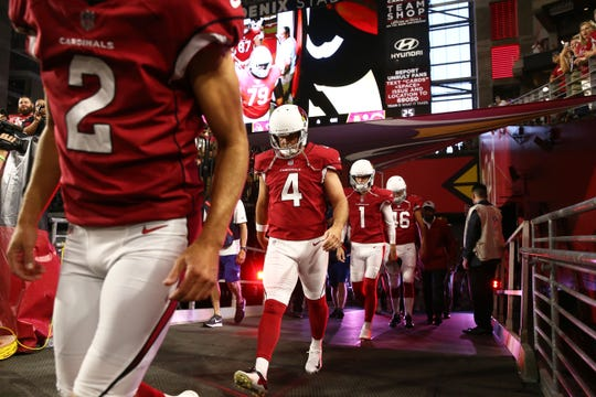 Cardinals kicker Phil Dawson (4) takes the field before a preseason game in August.