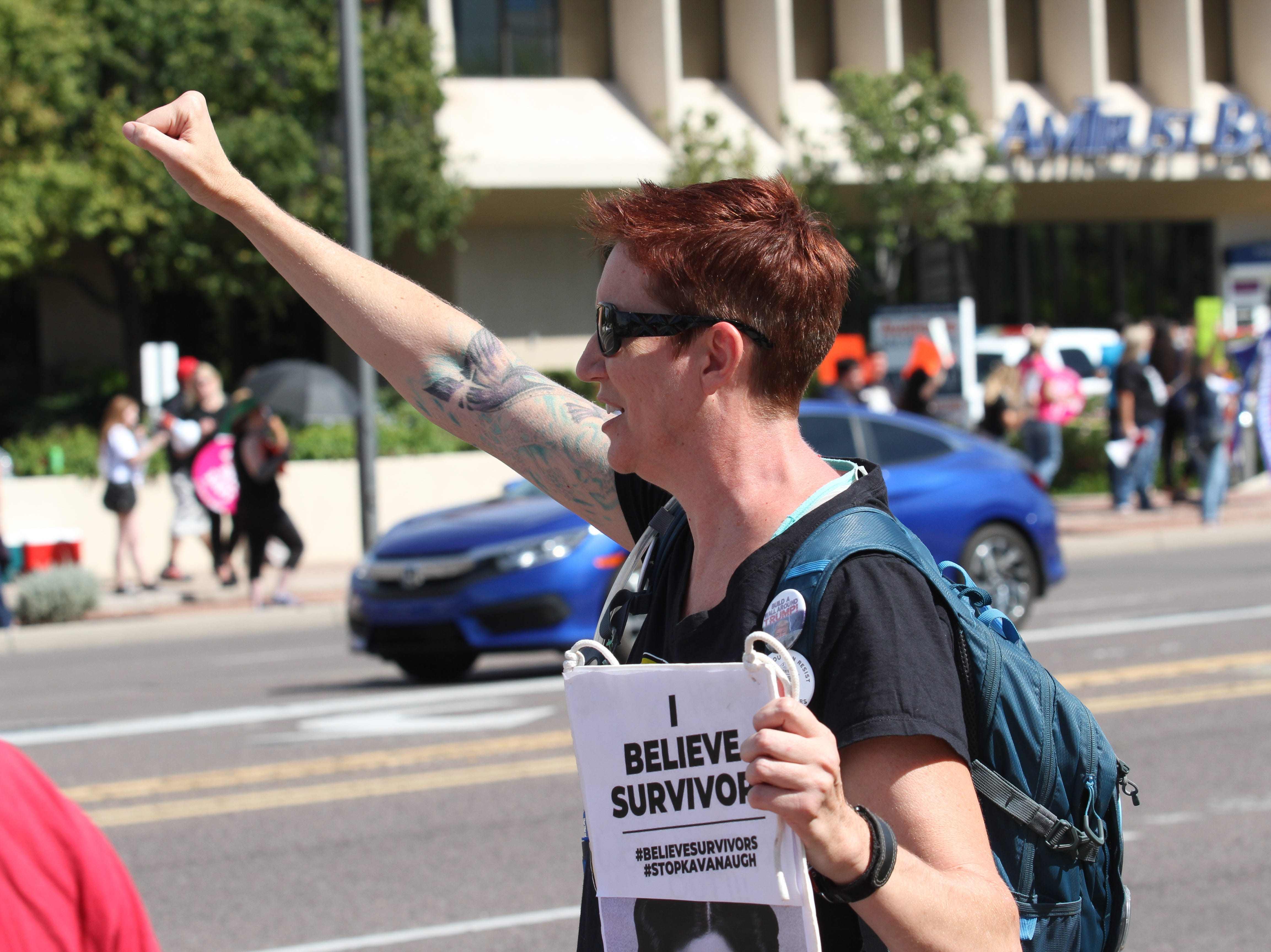 Judith Danvers, an anti-Kavanagh protester rallies outside Sen. Flake's Phoenix office on Saturday Nov. 6, 2018.