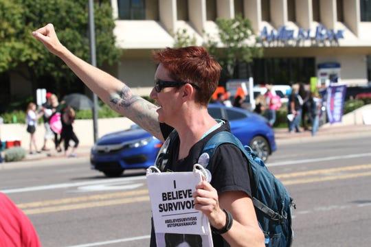 Judith Danvers, an anti-Kavanaugh protester rallies outside Sen. Flake's Phoenix office on Saturday, Nov. 6, 2018.