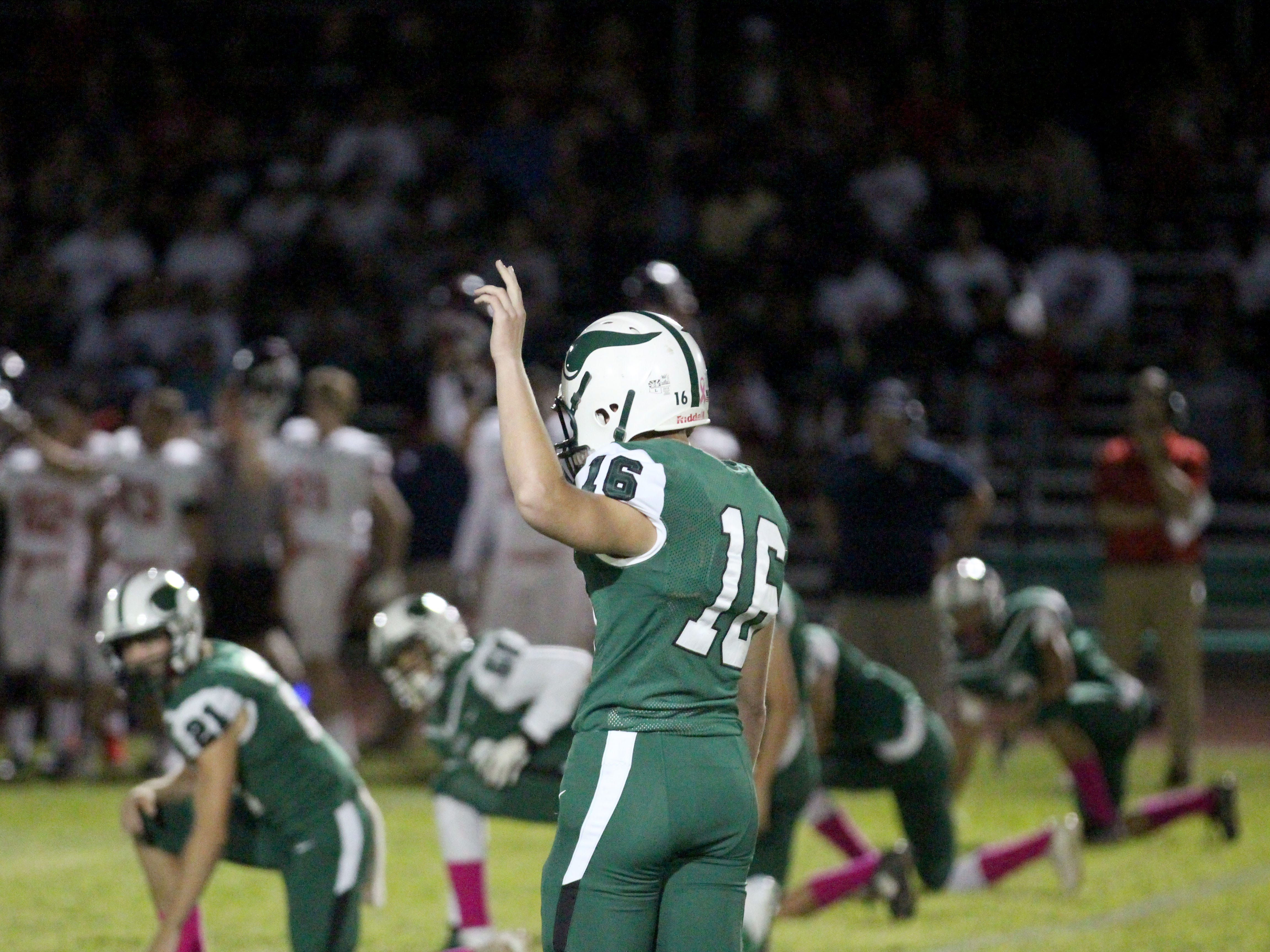 Sunnyslope kicker Peter Seivert signals that he is about to kick it off against Centennial on Friday night at Sunnyslope High School on Oct. 5, 2018