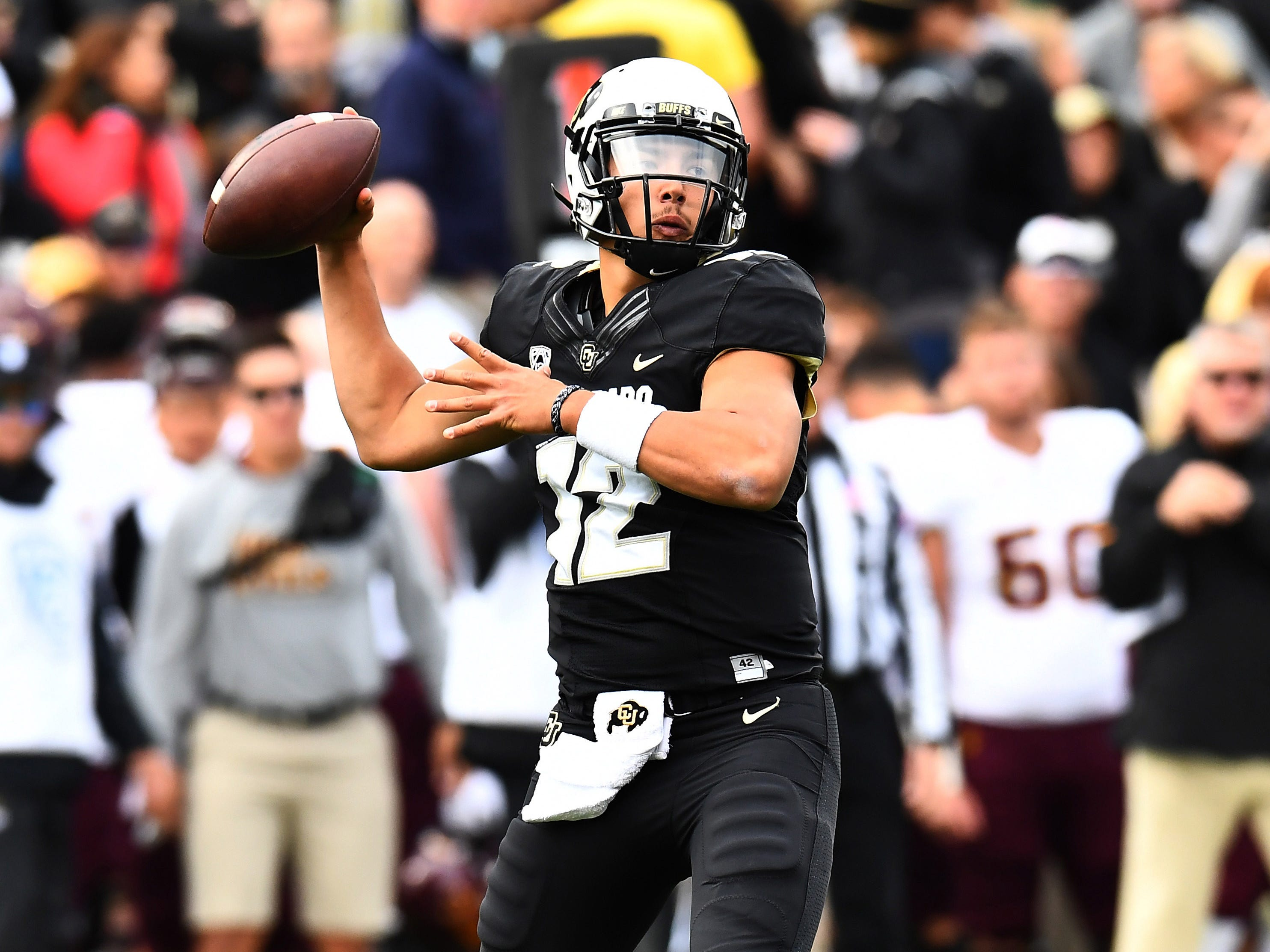 Oct 6, 2018; Boulder, CO, USA; Colorado Buffaloes quarterback Steven Montez (12) looks to pass in the first quarter against the Arizona State Sun Devils at Folsom Field. Mandatory Credit: Ron Chenoy-USA TODAY Sports