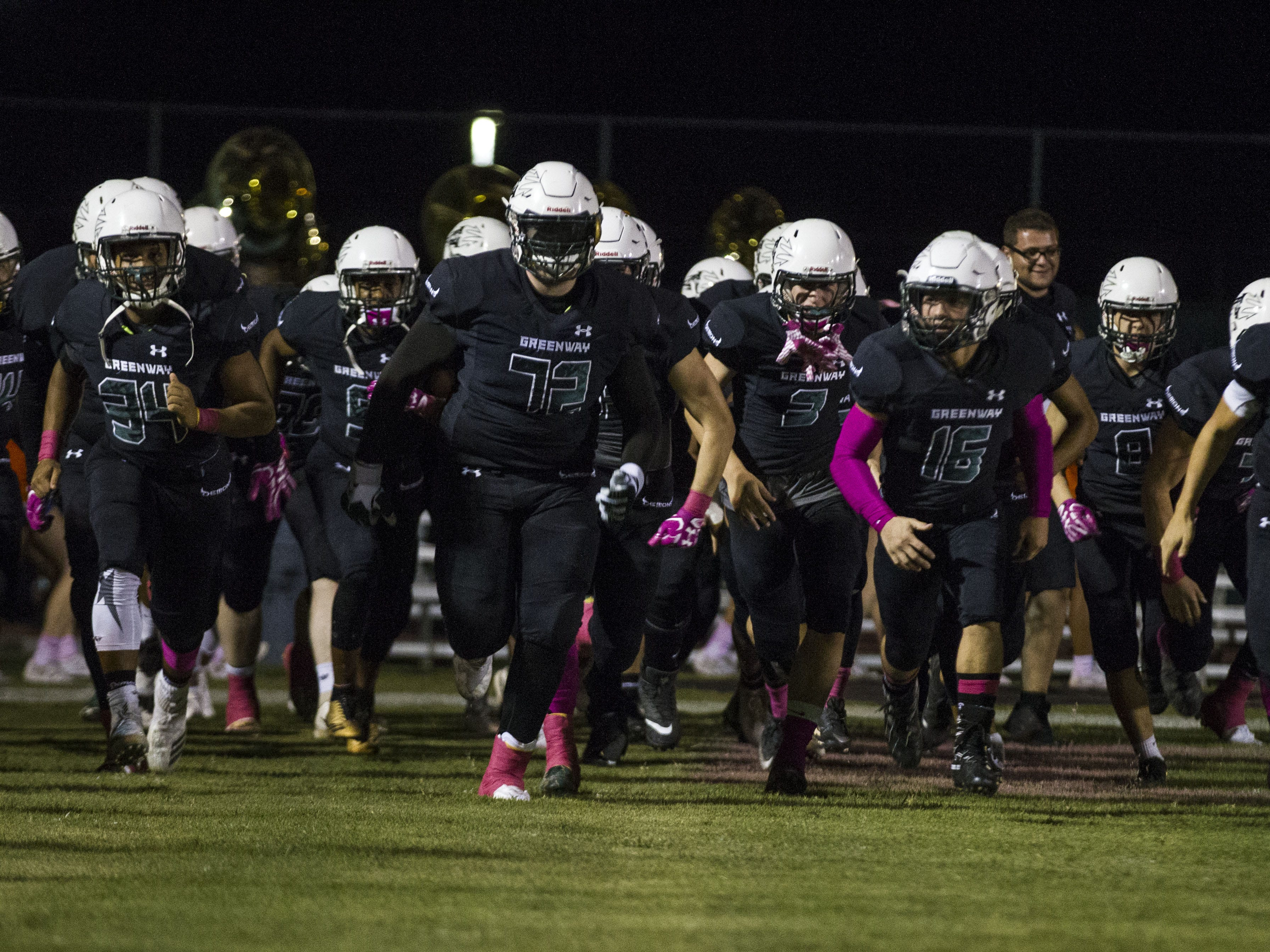 Washington High School players run out on to the field before their game with Thunderbird in Phoenix Friday, Oct. 5, 2018. #azhsfb