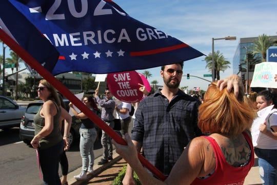 Lesa Anton, a member of the Patriot Movement, debates with an anti-Kavanaugh protester outside Sen. Flake's Phoenix office on Saturday, Nov. 6, 2018.