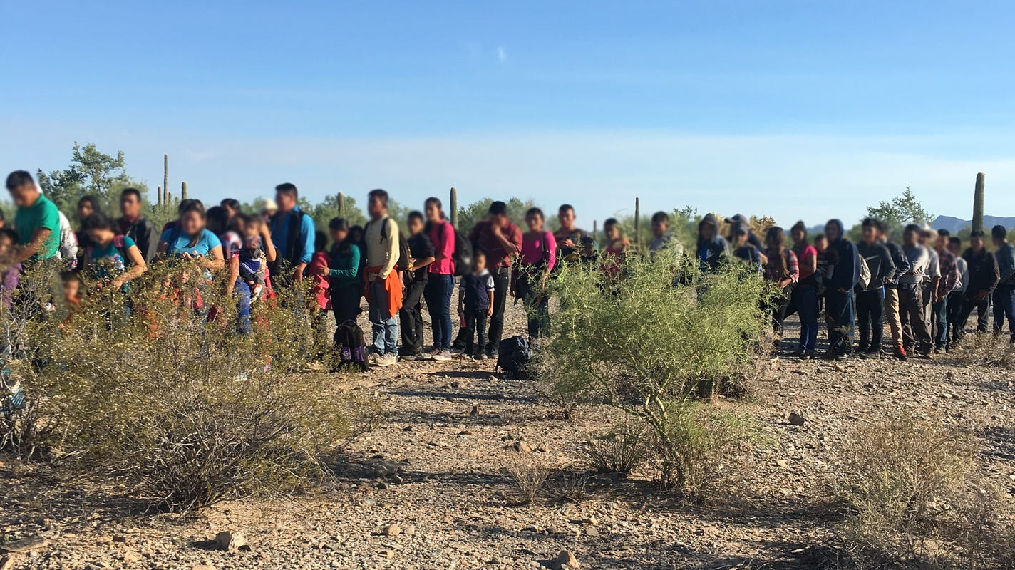 U.S. Border Patrol agents detain a group of 103 migrants near Lukeville