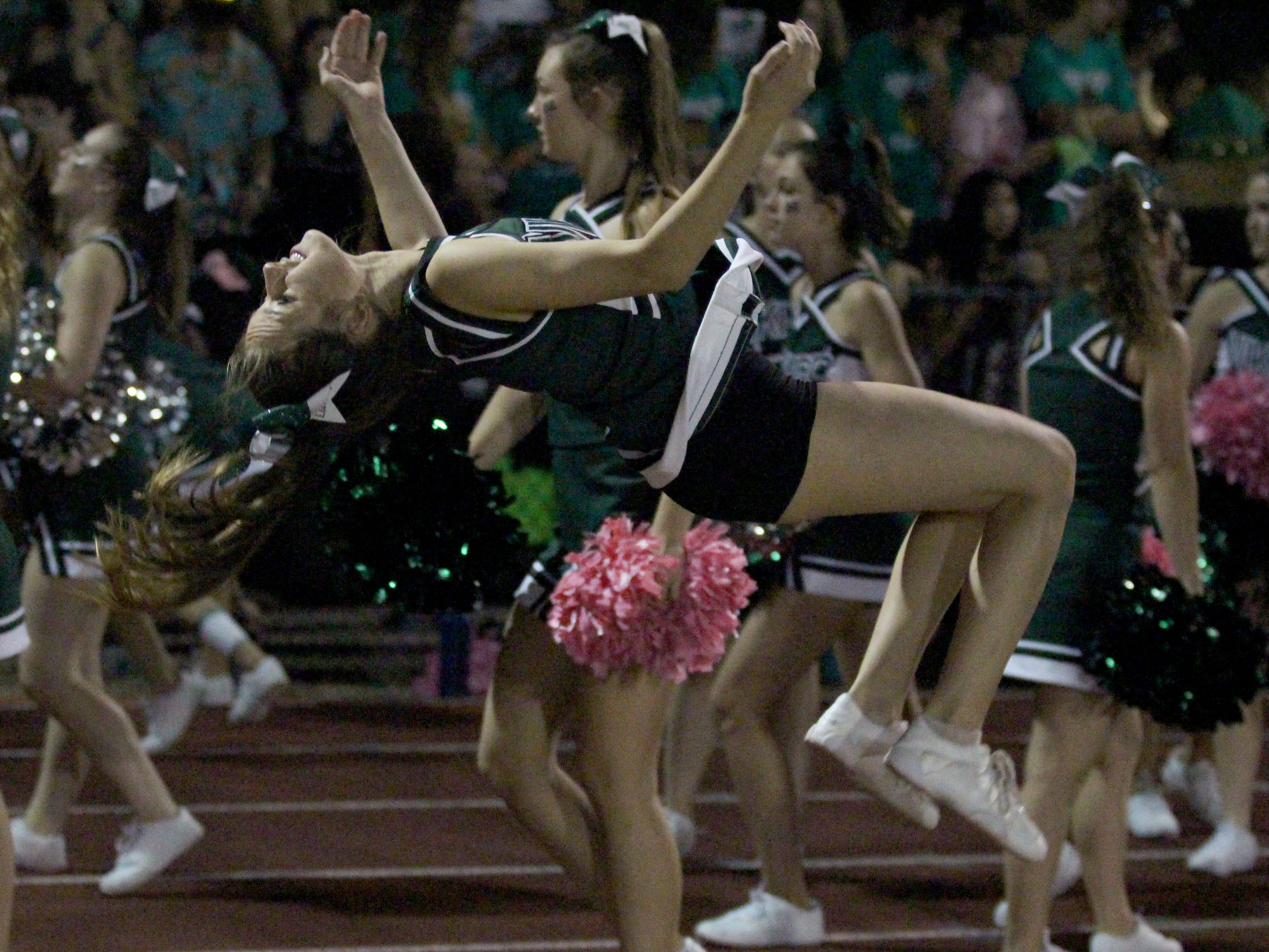 A Sunnyslope cheerleader does a backflip before the Centennial vs Sunnyslope game on Friday night at Sunnyslope High School on Oct. 5, 2018