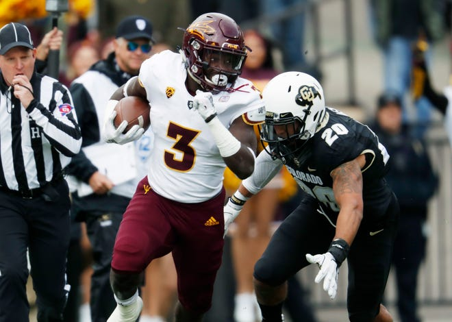 Arizona State running back Eno Benjamin, front, runs for a long gain as Colorado linebacker Drew Lewis pursues in the first half of an NCAA college football game Saturday, Oct. 6, 2018, in Boulder, Colo. (AP Photo/David Zalubowski)