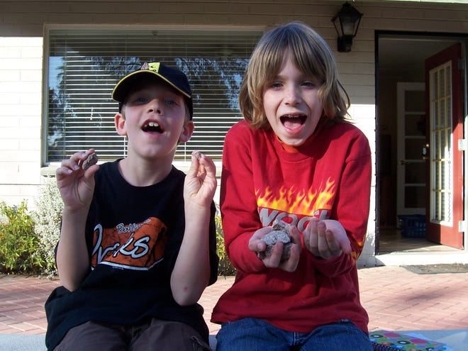 Sawyer (right) with two handfuls of rocks with his friend Jacob.