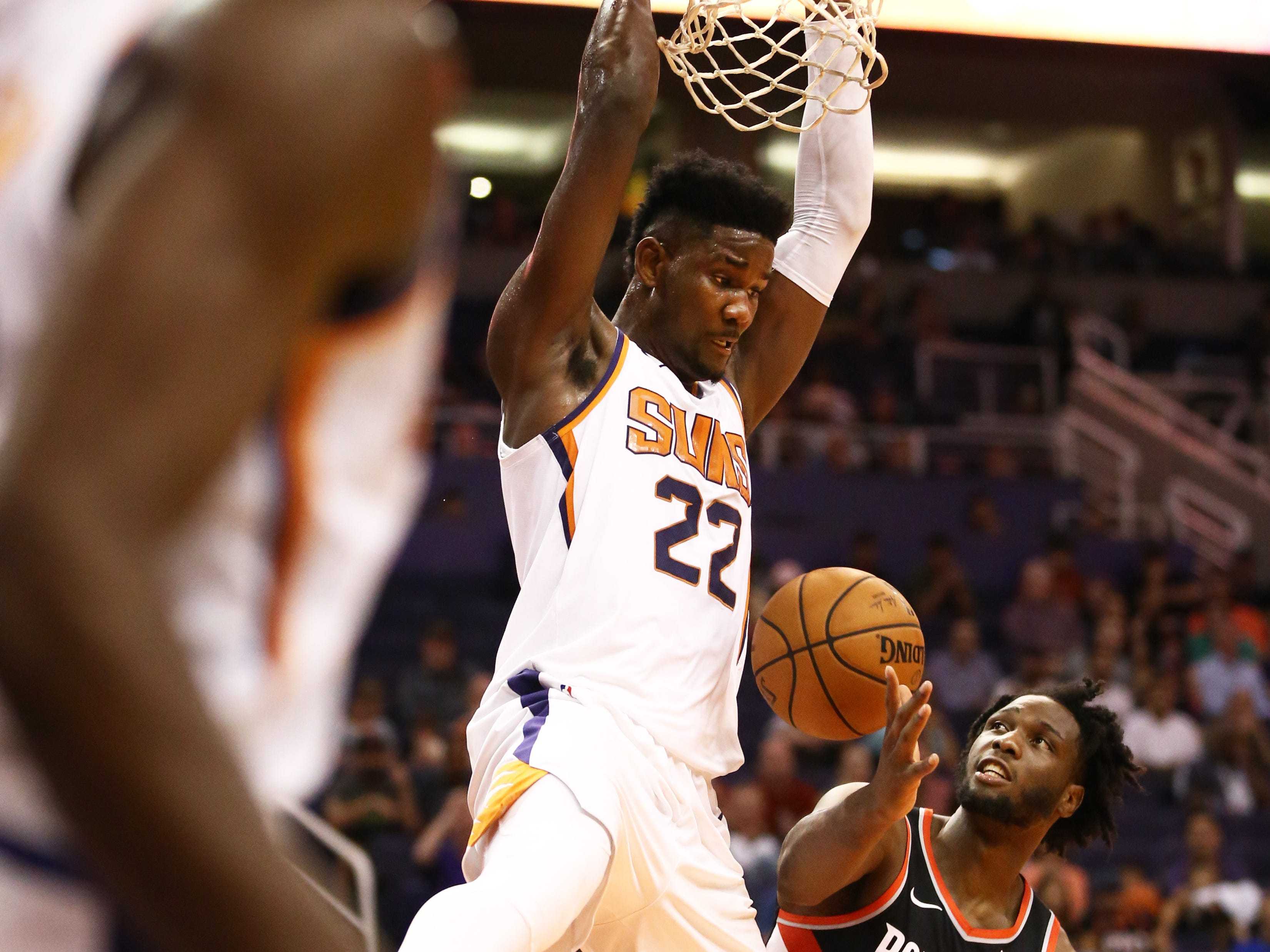 Phoenix Suns center Deandre Ayton shoots dunks the ball against the Portland Trail Blazers during a preseason game at Talking Stick Resort Arena on Oct. 5, 2018, in Phoenix, Ariz.