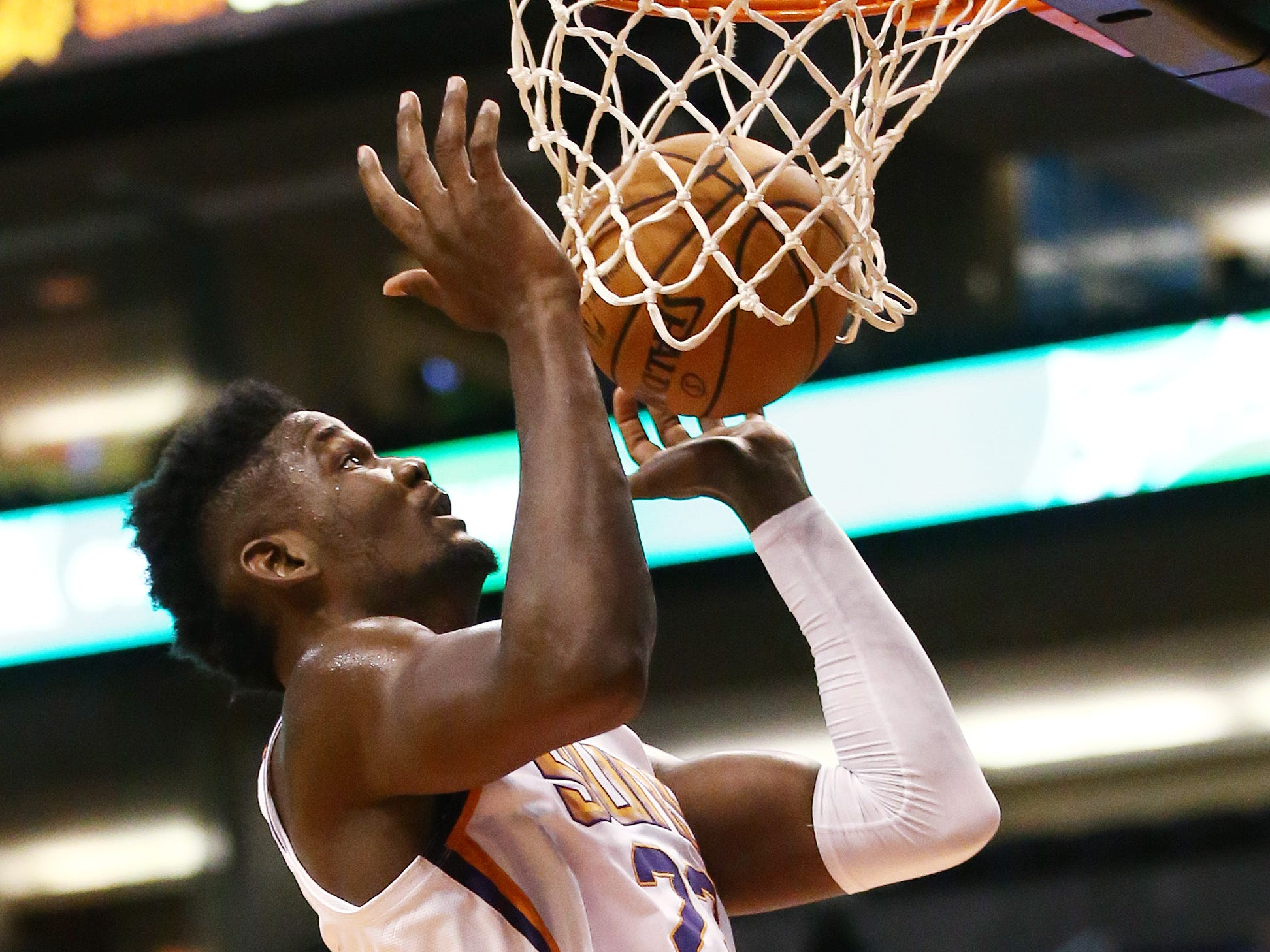 Phoenix Suns center Deandre Ayton drops the ball into the hoop against the Portland Trail Blazers during a preseason game at Talking Stick Resort Arena on Oct. 5, 2018, in Phoenix, Ariz.