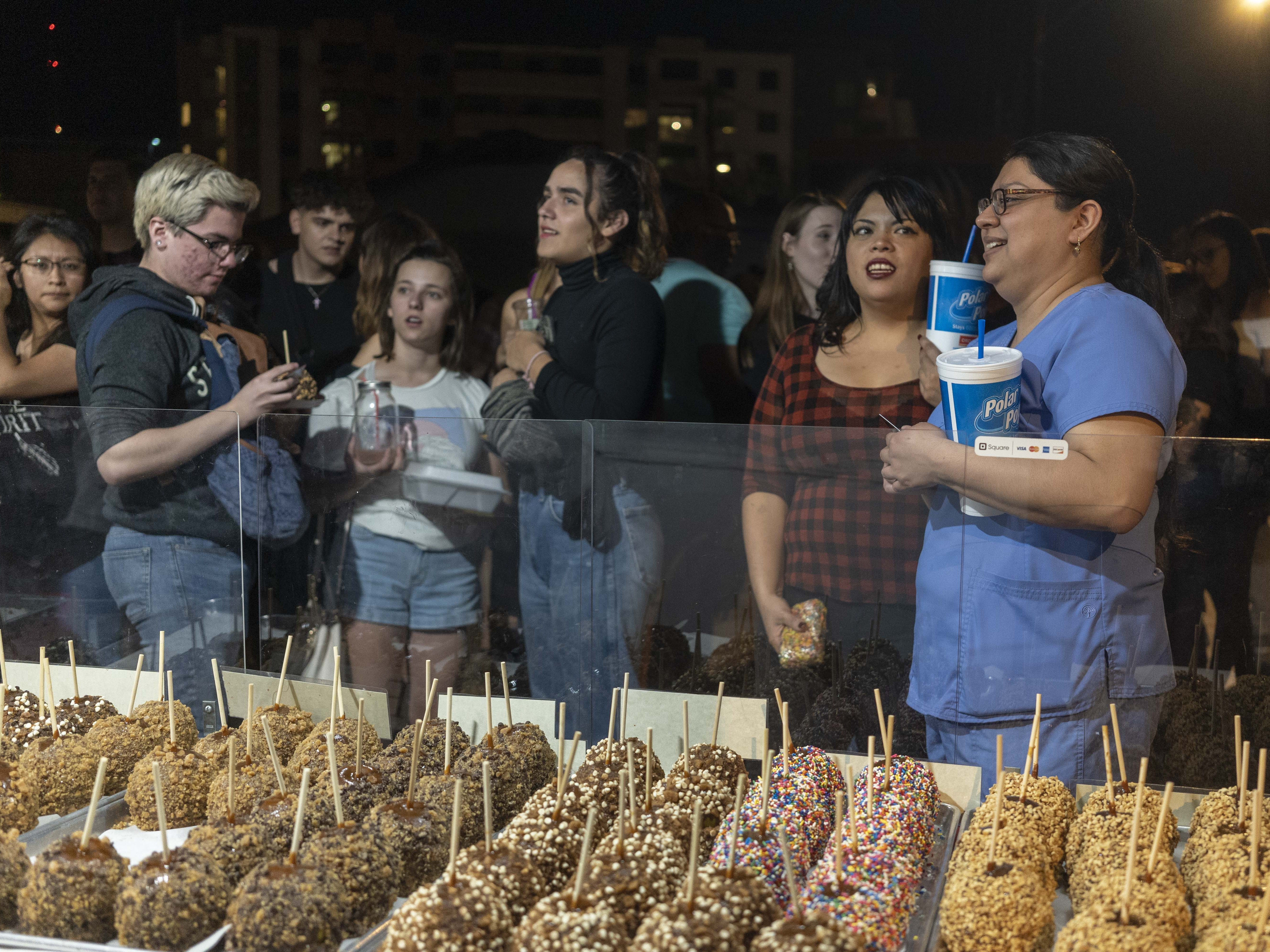 People enjoy food and artwork during the First Friday Art walk, on Roosevelt Street in Downtown Phoenix, on Oct. 5, 2018.