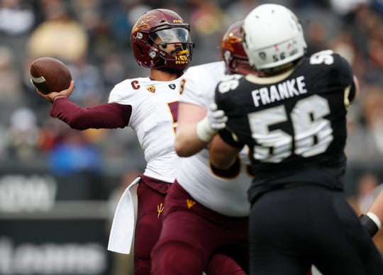 Arizona State quarterback Manny Wilkins, back, throws a pass against against Colorado in the first half of an NCAA college football game Saturday, Oct. 6, 2018, in Boulder, Colo. (AP Photo/David Zalubowski)